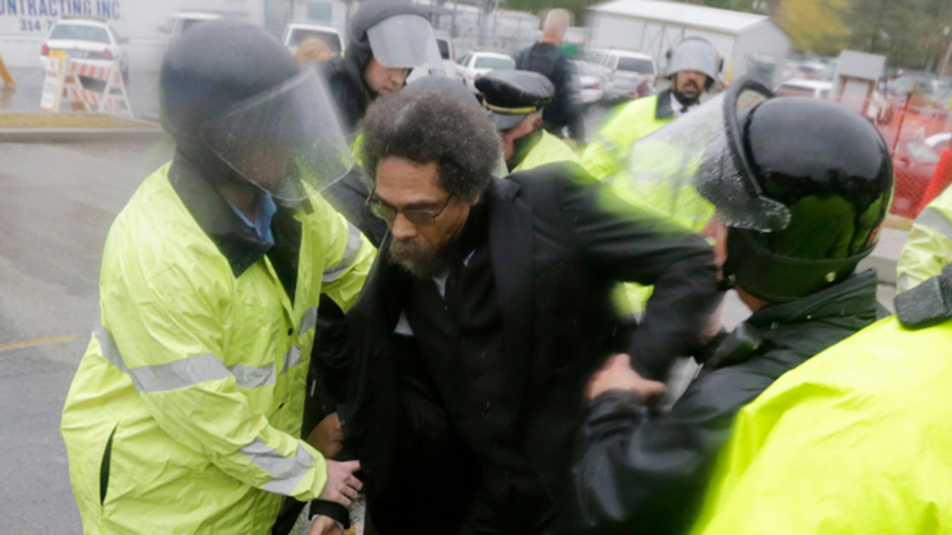 Oct. 13, 2014: Philosopher Cornel West, center, is taken into custody after performing an act of civil disobedience at the Ferguson, Mo., police station.