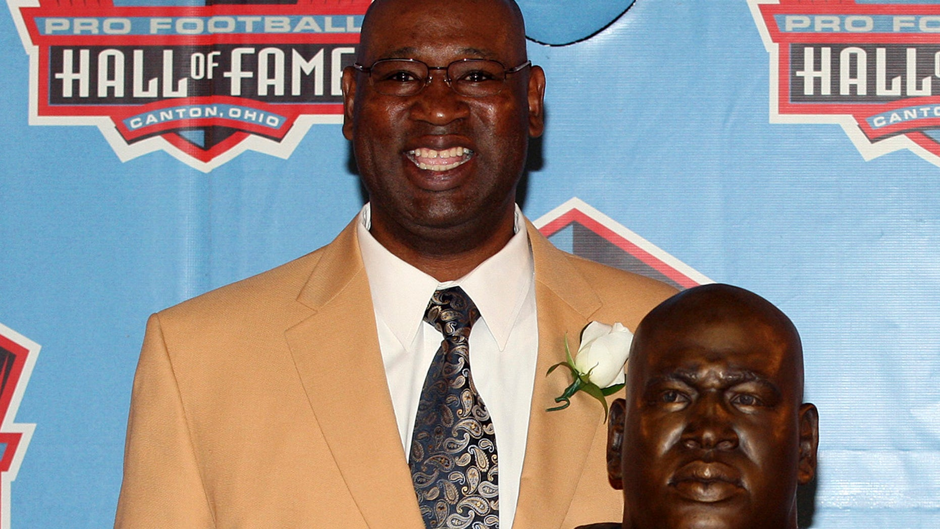 Former Seattle Seahawk Cortez Kennedy stands with his bust after being accepted into the Pro Football Hall of Fame in Canton, Ohio August 4, 2012. Kennedy was found dead on Tuesday in Orlando. REUTERS/Aaron Josefczyk