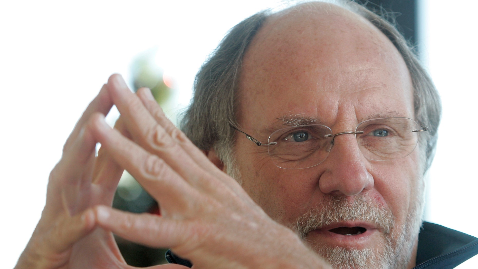 In this Jan. 9, 2011 file photo, former New Jersey Gov. Jon S. Corzine reflects on his four year term in office during an interview with The Associated Press at his home in Hoboken, N.J.
