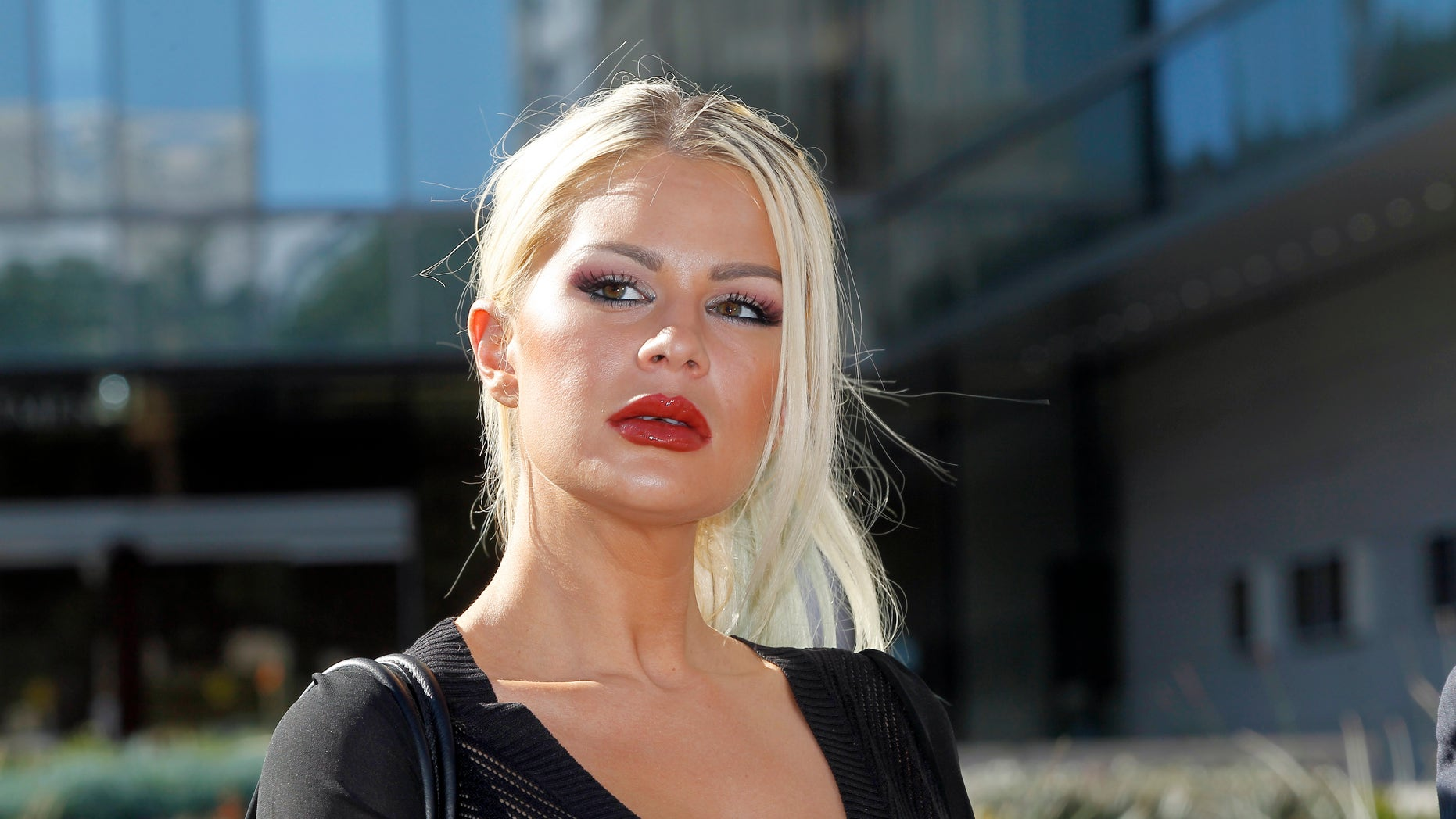 Jan. 14, 2015. Chloe Goins, a model who claims entertainer Bill Cosby drugged and sexually abused her at the Playboy Mansion in 2008, appears before reporters outside Los Angeles police headquarters after meeting police investigators in Los Angeles.