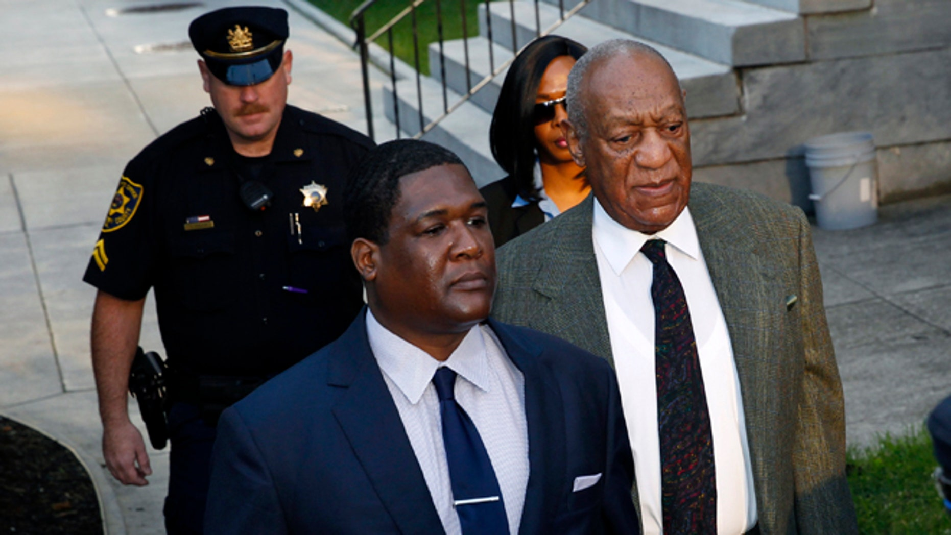 Bill Cosby, right, arrives for a hearing in his sexual assault case at the Montgomery County Courthouse on Wednesday, Nov. 2, 2016, in Norristown, Pa.