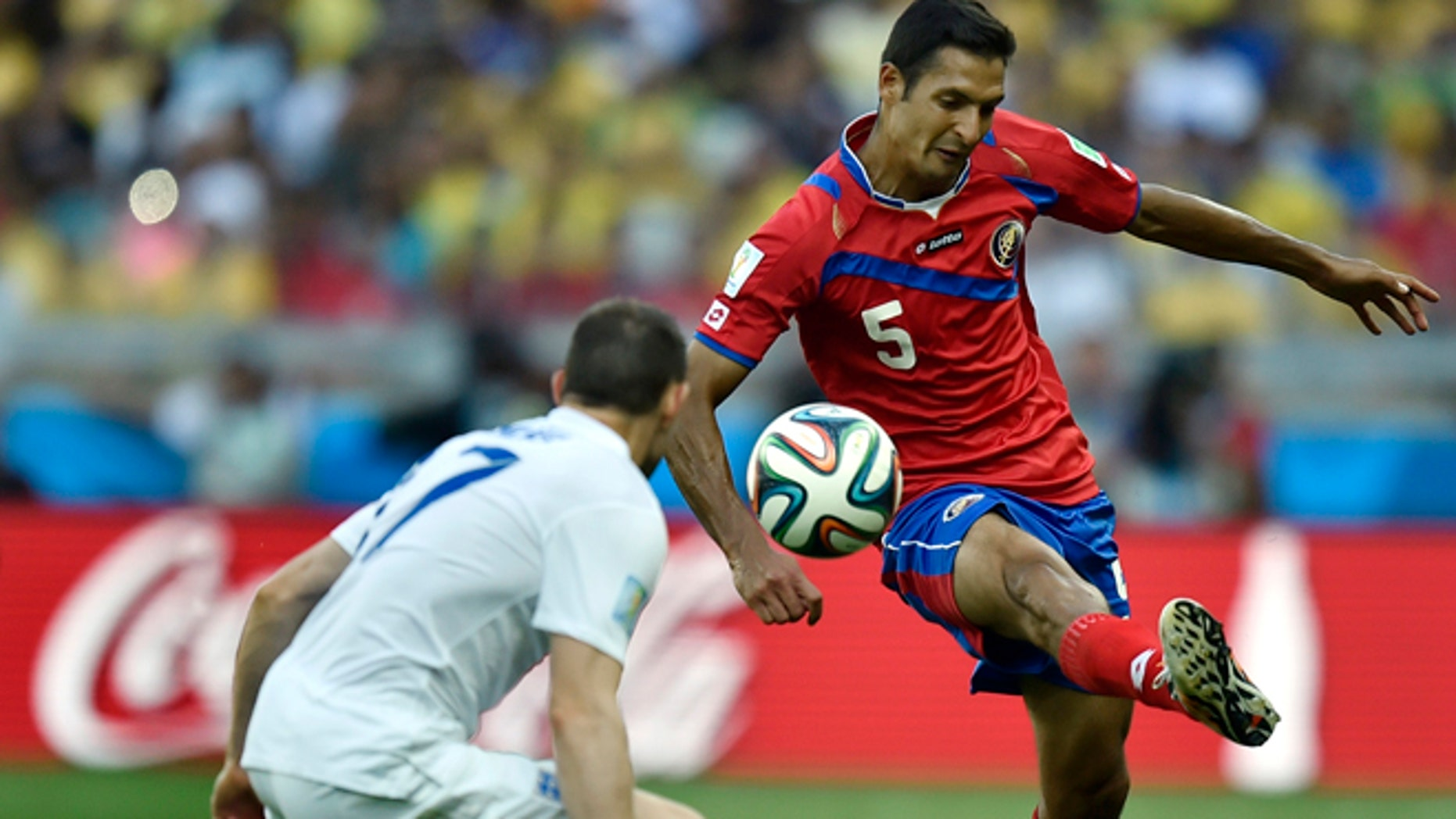 June 24, 2014: Costa Rica's Celso Borges, right, controls the ball past England's Jack Wilshere during the group D World Cup soccer match between Costa Rica and England at the Mineirao Stadium in Belo Horizonte, Brazil.