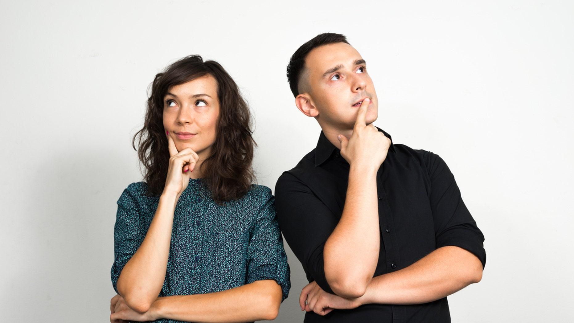 Horizontal studio shot of couple thinking