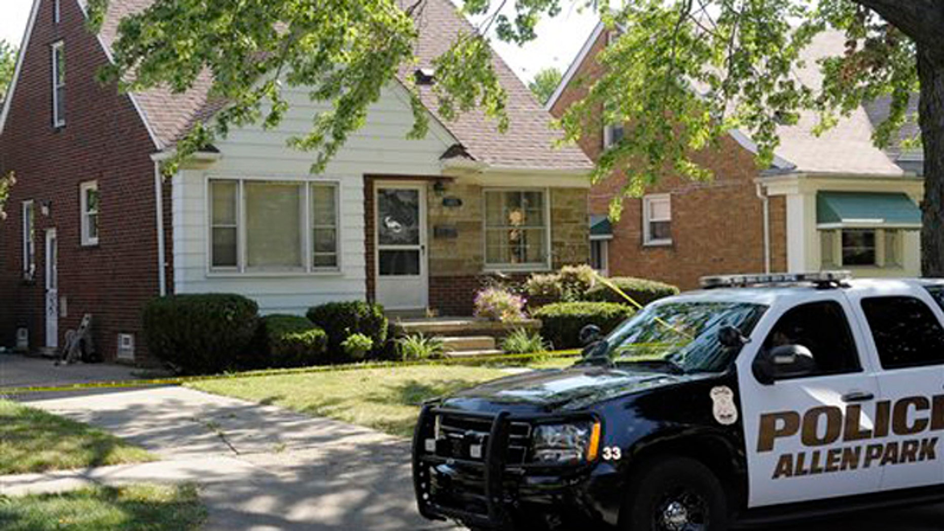 July 20, 2012: An Allen Park Police wait outside an Allen Park, Mich., home.