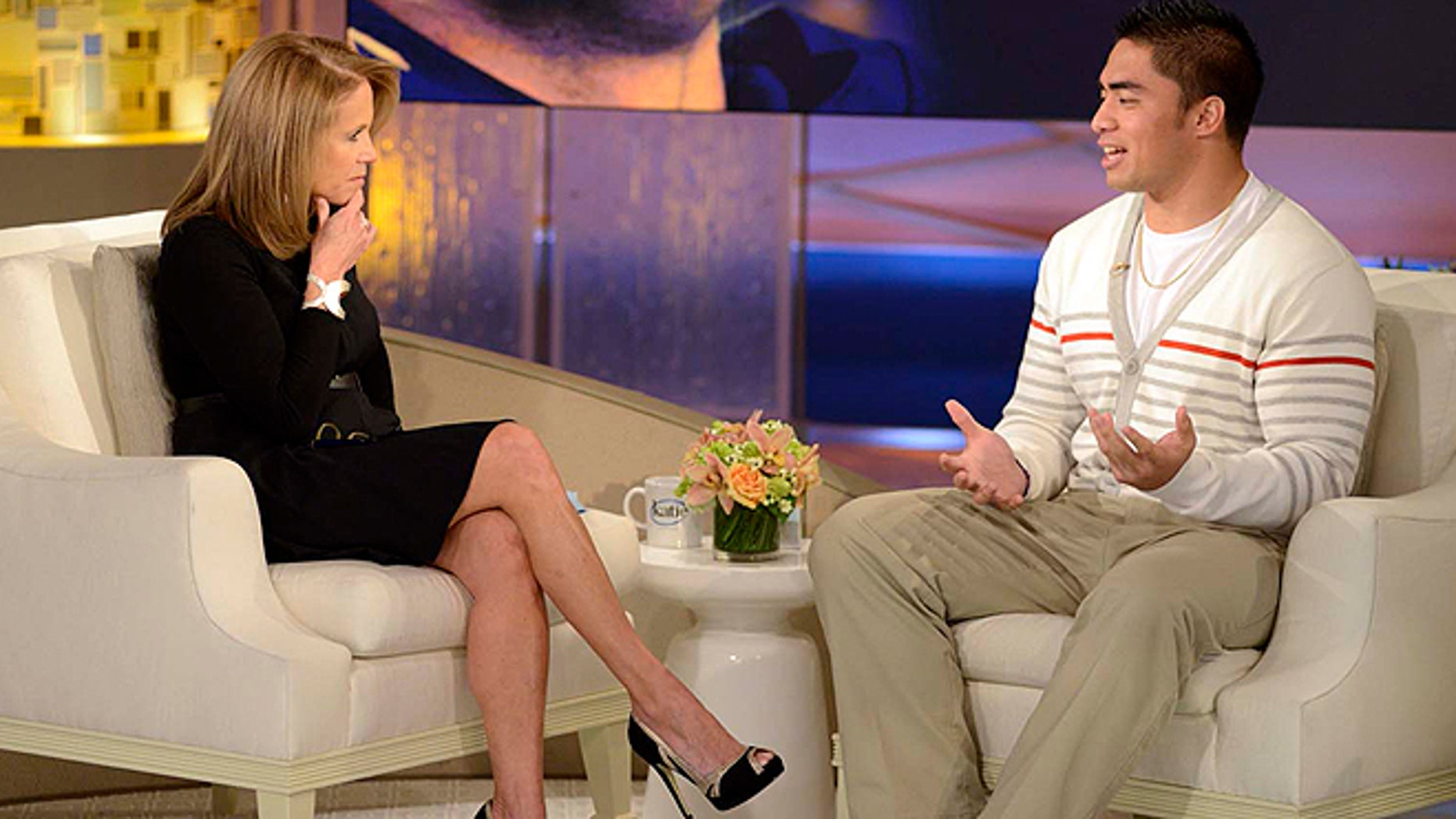 Jan. 22, 2013: Notre Dame linebacker Manti Te'o, right, speaking with host Katie Couric during an interview for 'Katie' in New York. Te'o told Couric he briefly lied about his online girlfriend after discovering she didn't exist, but maintained he had no part in creating the hoax. (AP/Disney-ABC)