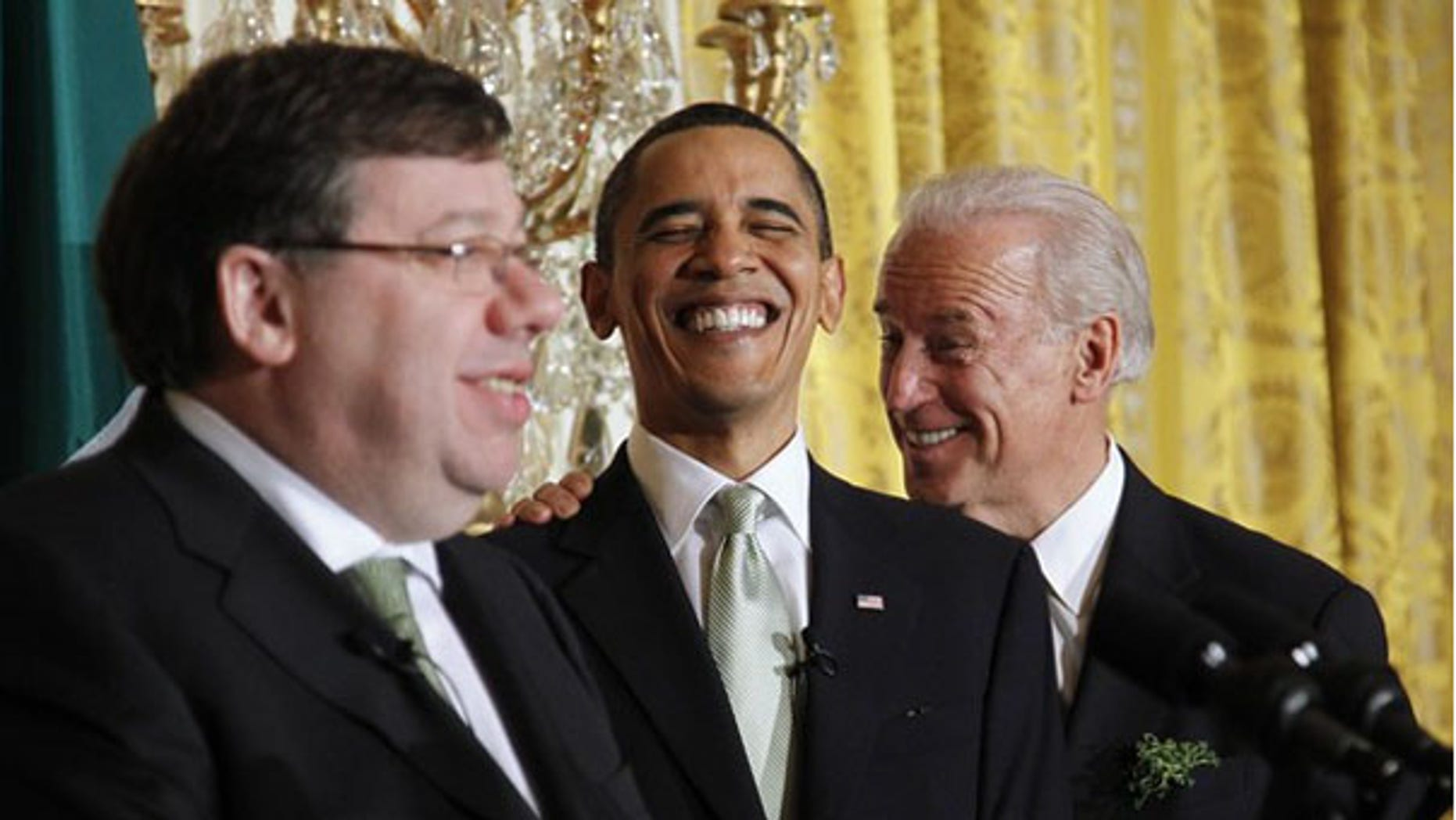 President Obama reacts to remarks by Vice President Biden as Irish Prime Minister Brian Cowen, left, speaks at a St. Patricks Day reception at the White House March 17. (Reuters Photo)