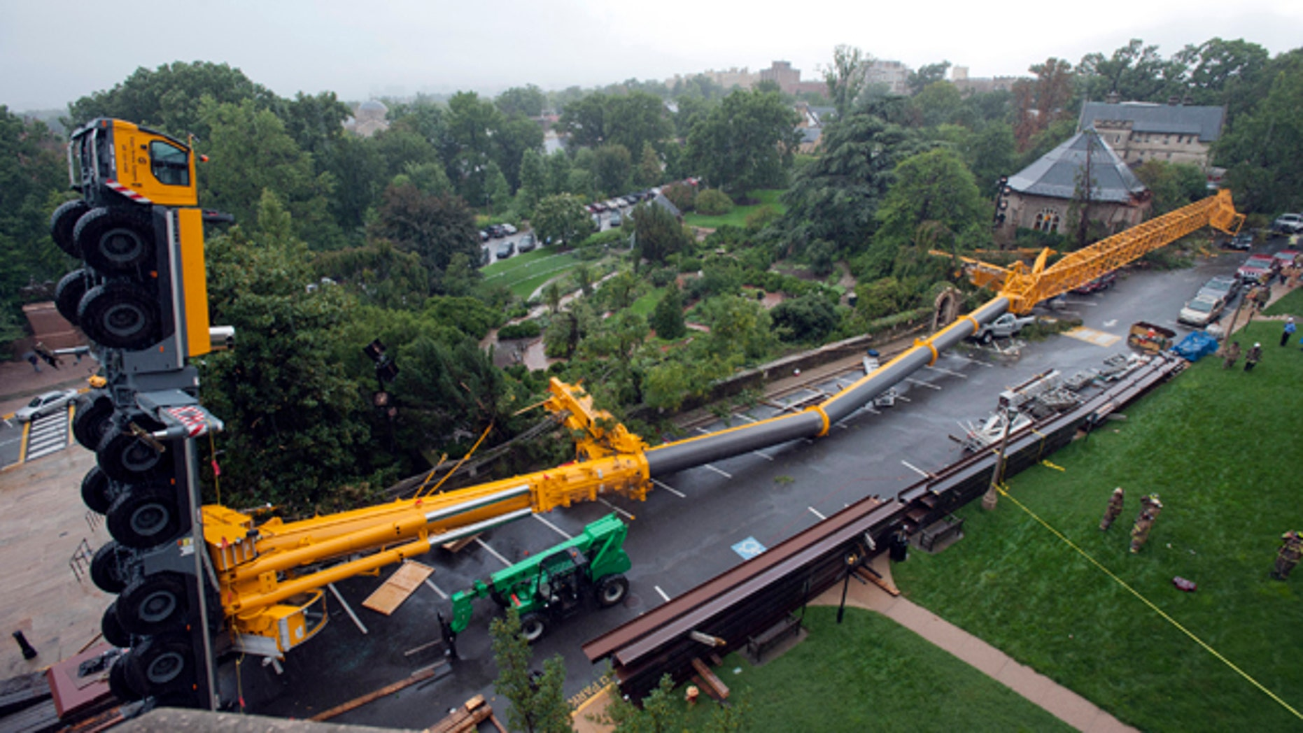 This image released the the National Cathedral shows a 500-ton crane that was doing repair work caused by the Aug. 23 east coast earthquake after it collapsed Wednesday, Sept. 7, 2011, at the Washington National Cathedral in Washington.