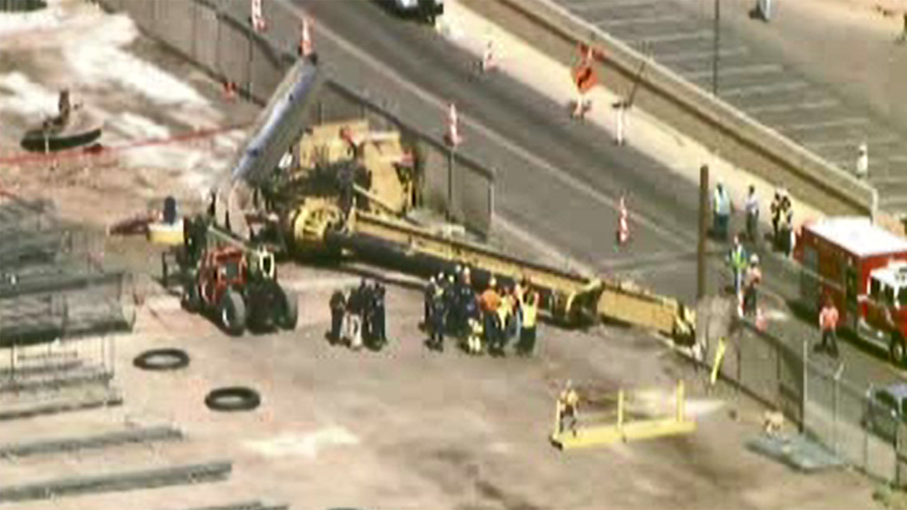 The crane was being utilized for construction of the airport's PHX Sky Train.