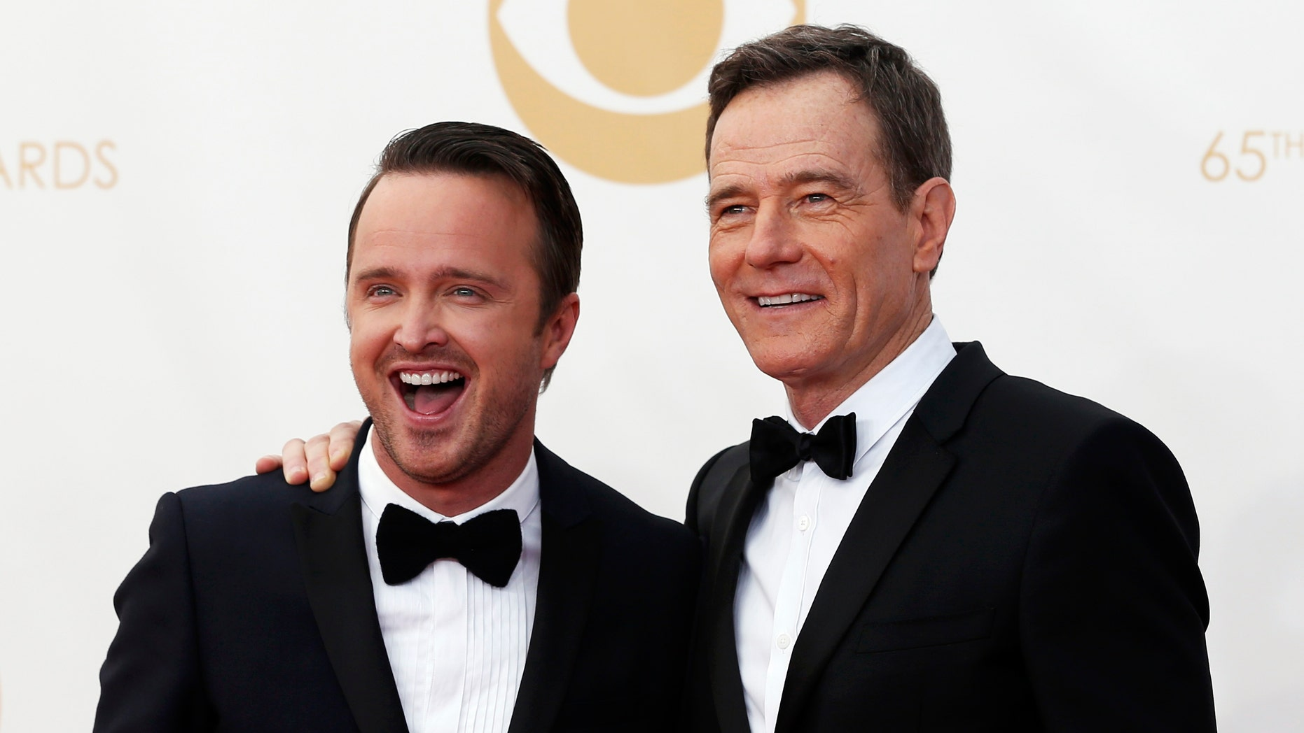 "September 22, 2013. Actors Aaron Paul (L) and Bryan Cranston from ""Breaking Bad""  arrive at the 65th Primetime Emmy Awards in Los Angeles."