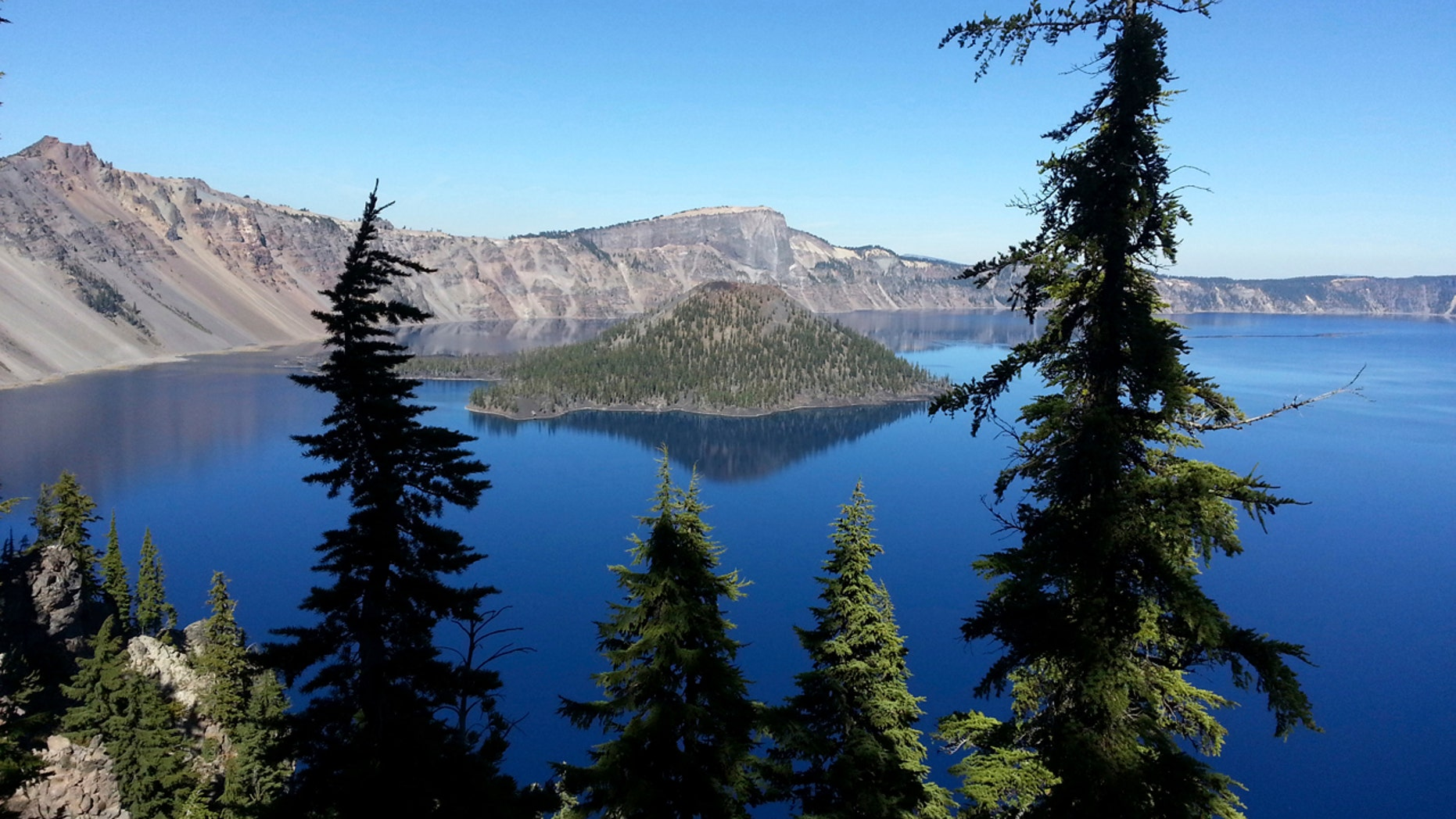 This Oct. 5, 2015, file photo shows Wizard Island in Crater Lake from the rim trail between Rim Village and Watchman Peak at Crater Lake, Ore.