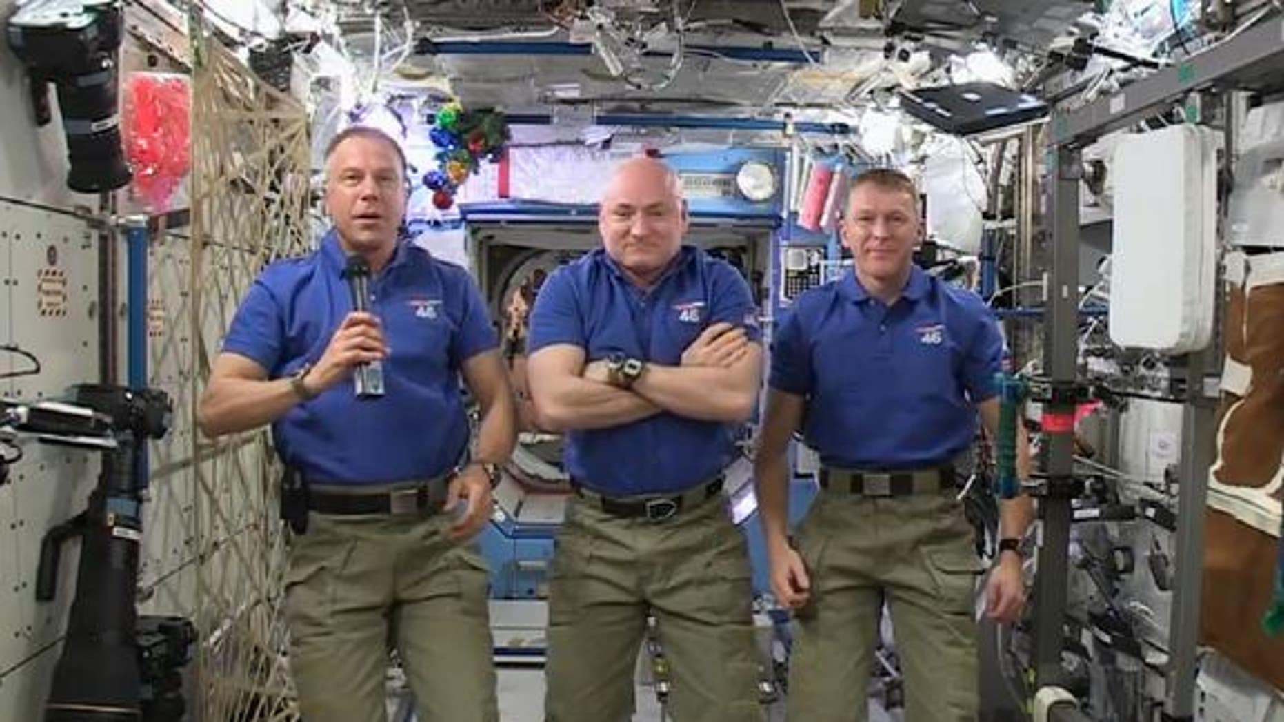 Astronauts Scott Kelly and Tim Kopra of NASA, and Tim Peake of the European Space Agency delivered a holiday message from the International Space Station on Dec. 18. The station Christmas tree can be seen just to the right of Kopra's head.