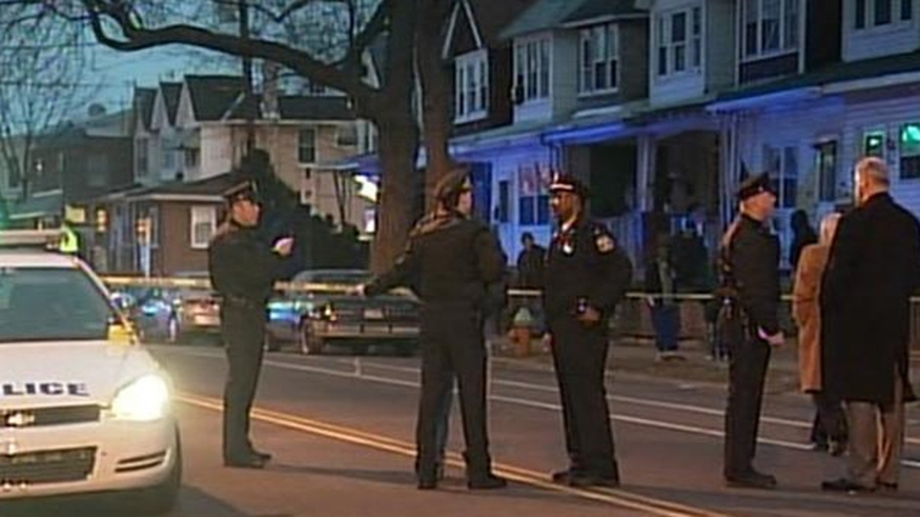 Police inspect the crime scene after a fatal Valentine's Day shooting.