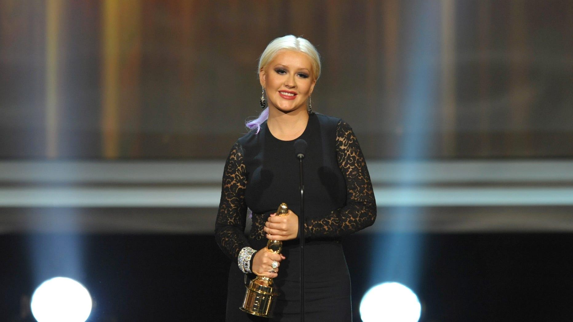 Christina Aguilera accepts the voice of a generation award at the ALMA Awards on Sunday, Sept. 16, 2012, in Pasadena, Calif. (Photo by John Shearer/Invision/AP)