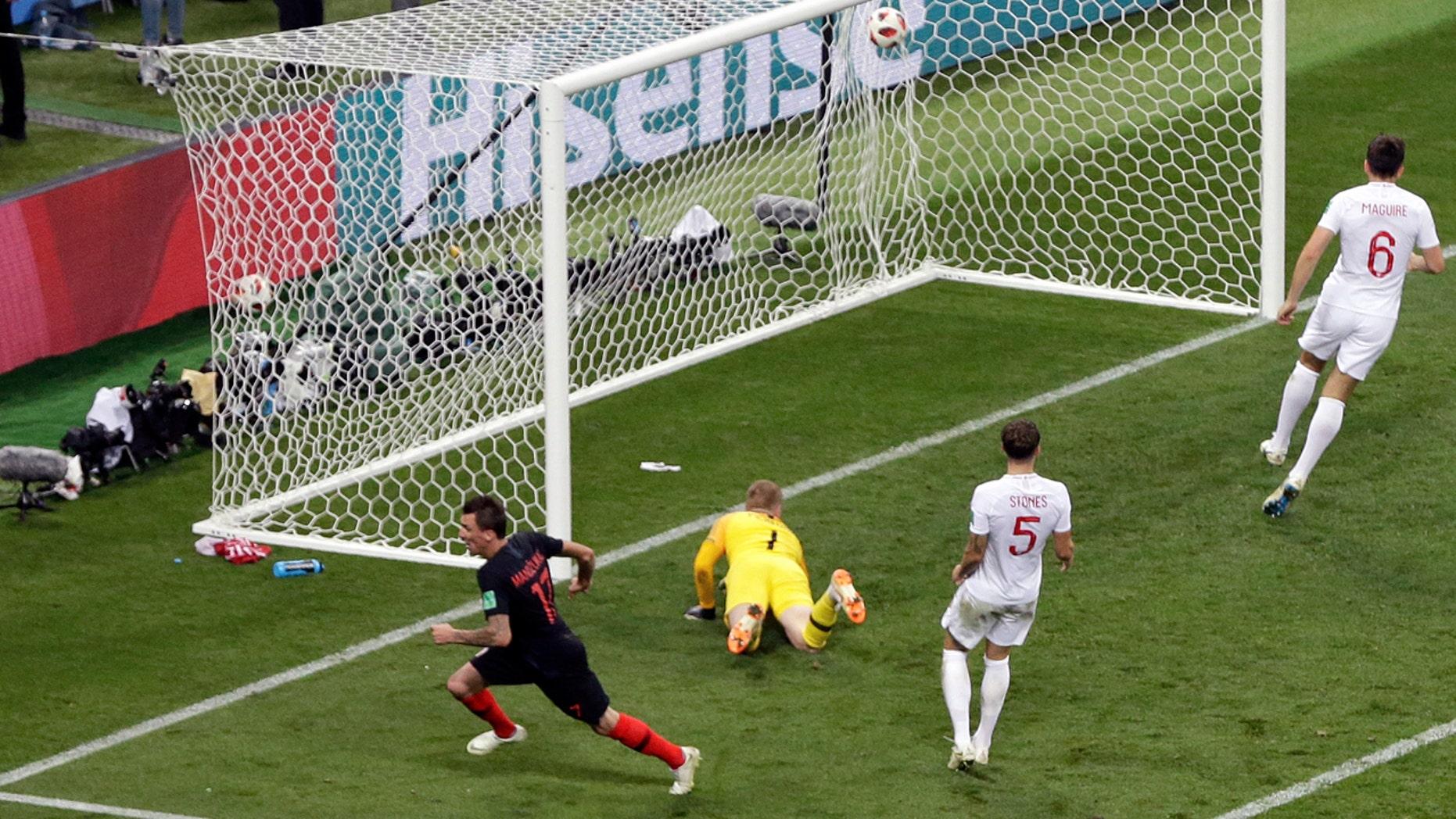 Mario Mandzukic wheels away after scoring the winning goal in Wednesday's semifinal between Croatia and England.