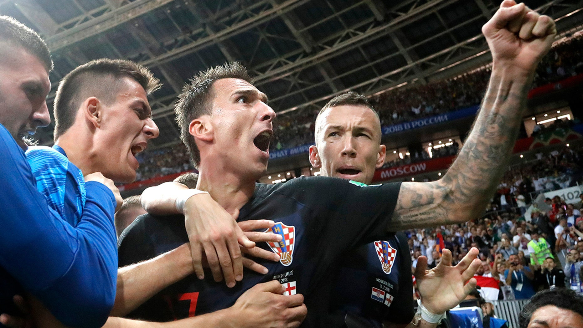 Croatia's Mario Mandzukic, center, celebrates after scoring his side's second goal during the semifinal match between Croatia and England at the 2018 FIFA World Cup, in Moscow, July 11, 2018.