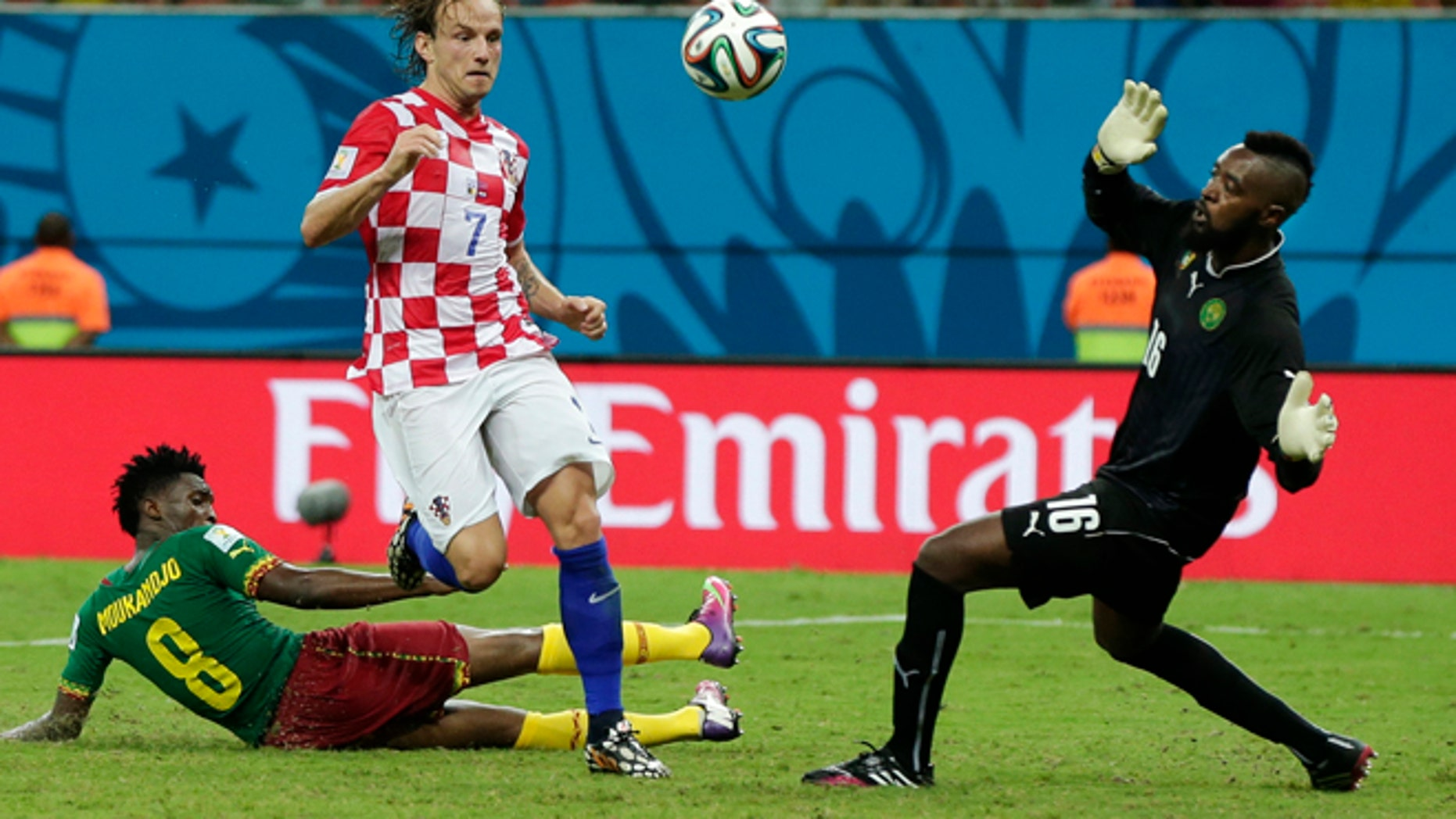 June 18, 2014: Croatia's Ivan Rakitic (7) kicks against Cameroon's goalkeeper Charles Itandje (16) during the group A World Cup soccer match between Cameroon and Croatia at the Arena da Amazonia in Manaus, Brazil.