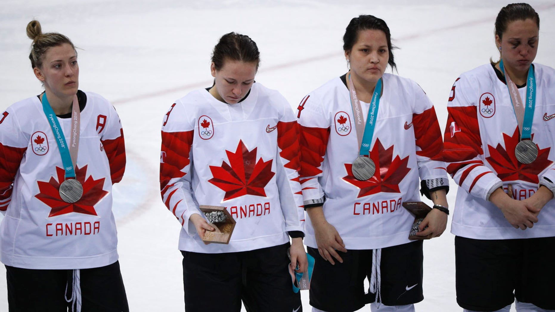 FILE:  Jocelyne Larocque of Canada holds her silver medal in her hand, next to teammates wearing their medals during the medal ceremony.