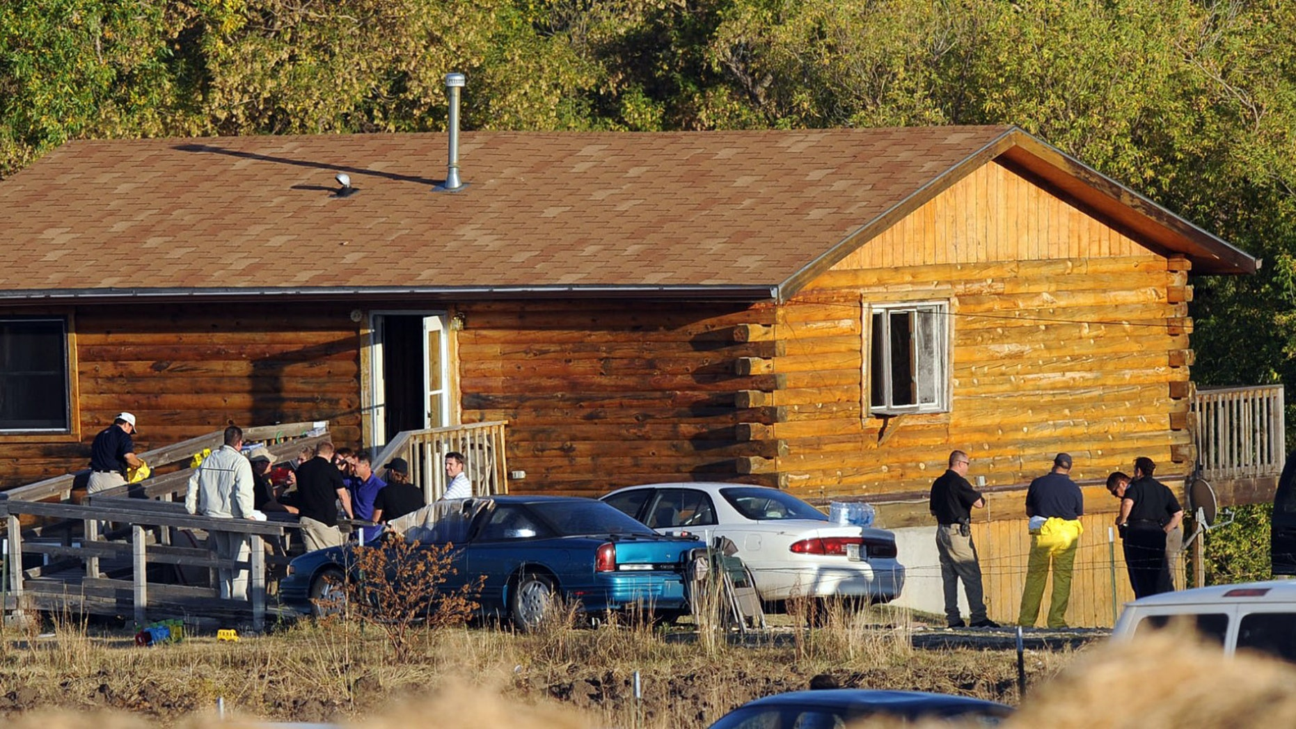 Oct. 4: Law enforcement officers remove a shooting victim's body from a home about nine miles south west of Lodge Grass near Montana's Crow Reservation.  A shooting left three people dead at a rural residence on Montana's Crow Reservation.
