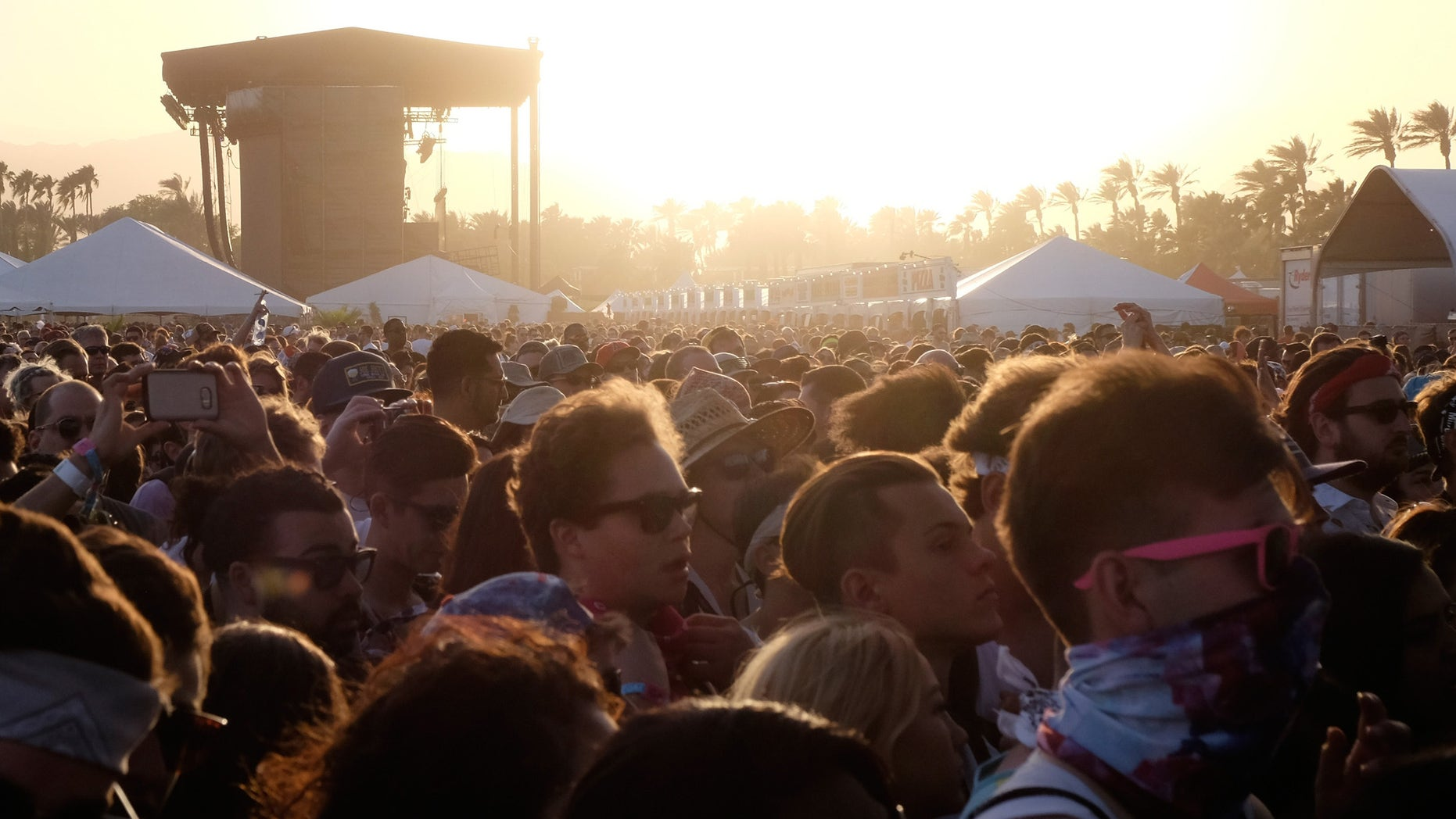 INDIO, CA - APRIL 15:  Festival goers at sunset during day 1 of the 2016 Coachella Valley Music & Arts Festival Weekend 1 at the Empire Polo Club on April 15, 2016 in Indio, California.  (Photo by Frazer Harrison/Getty Images for Coachella)