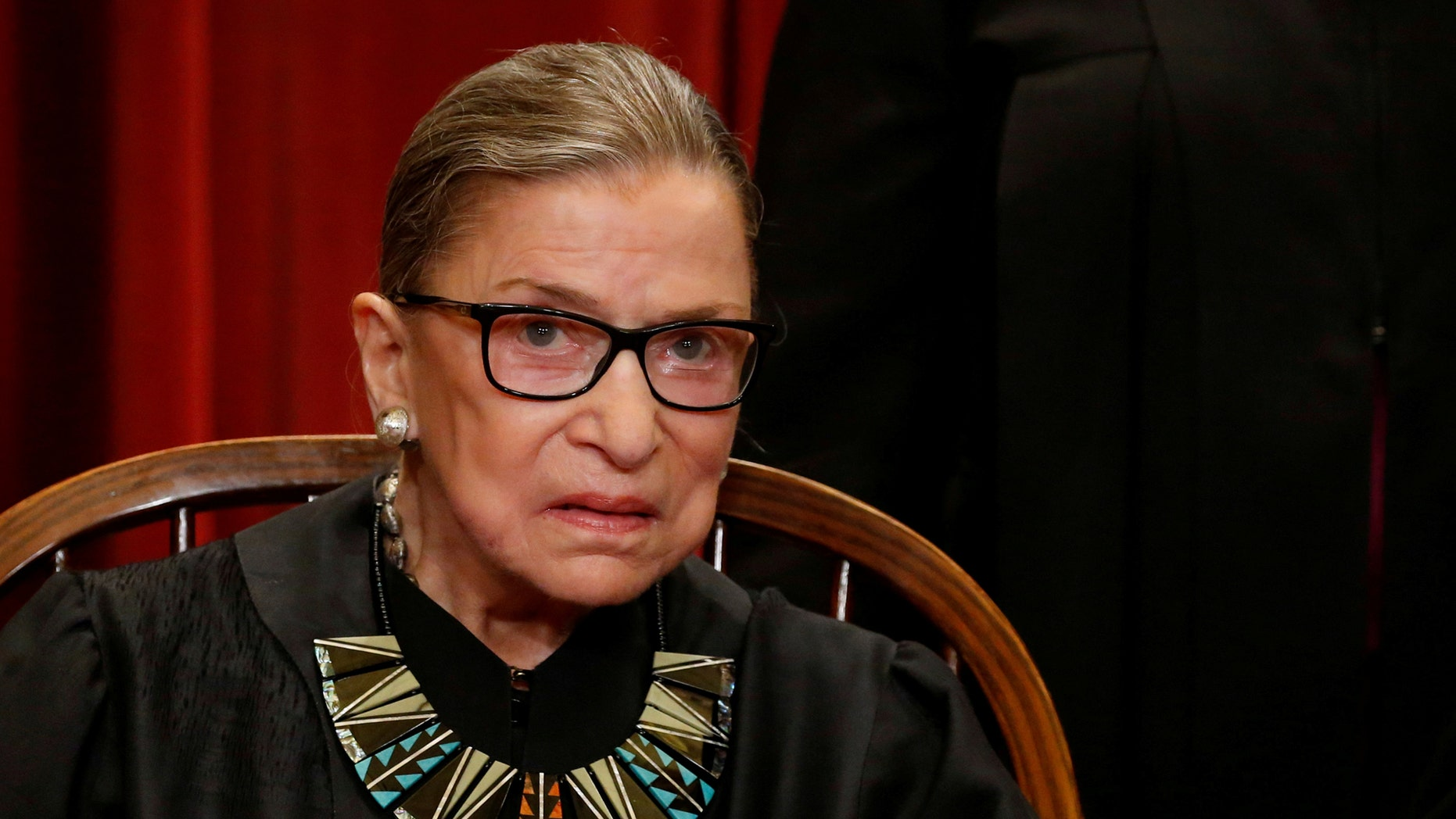 Supreme Court Justice Ruth Bader Ginsburg posing for a new 'family photo' in June 2017.