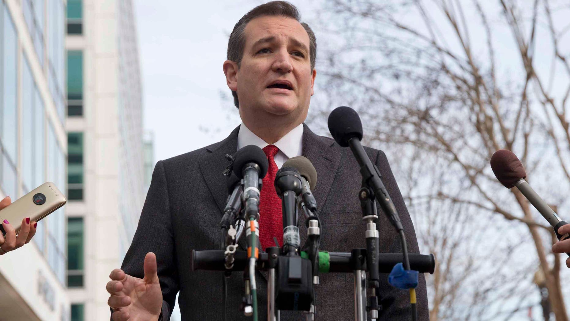 """Republican presidential candidate, Sen. Ted Cruz, R-Texas speaks to the media about events in Brussels, Tuesday, March 22, 2016, near the Capitol in Washington. Cruz said he would use the """"full force and fury"""" of the U.S. military to defeat the Islamic State group.  (AP Photo/Jacquelyn Martin)"""
