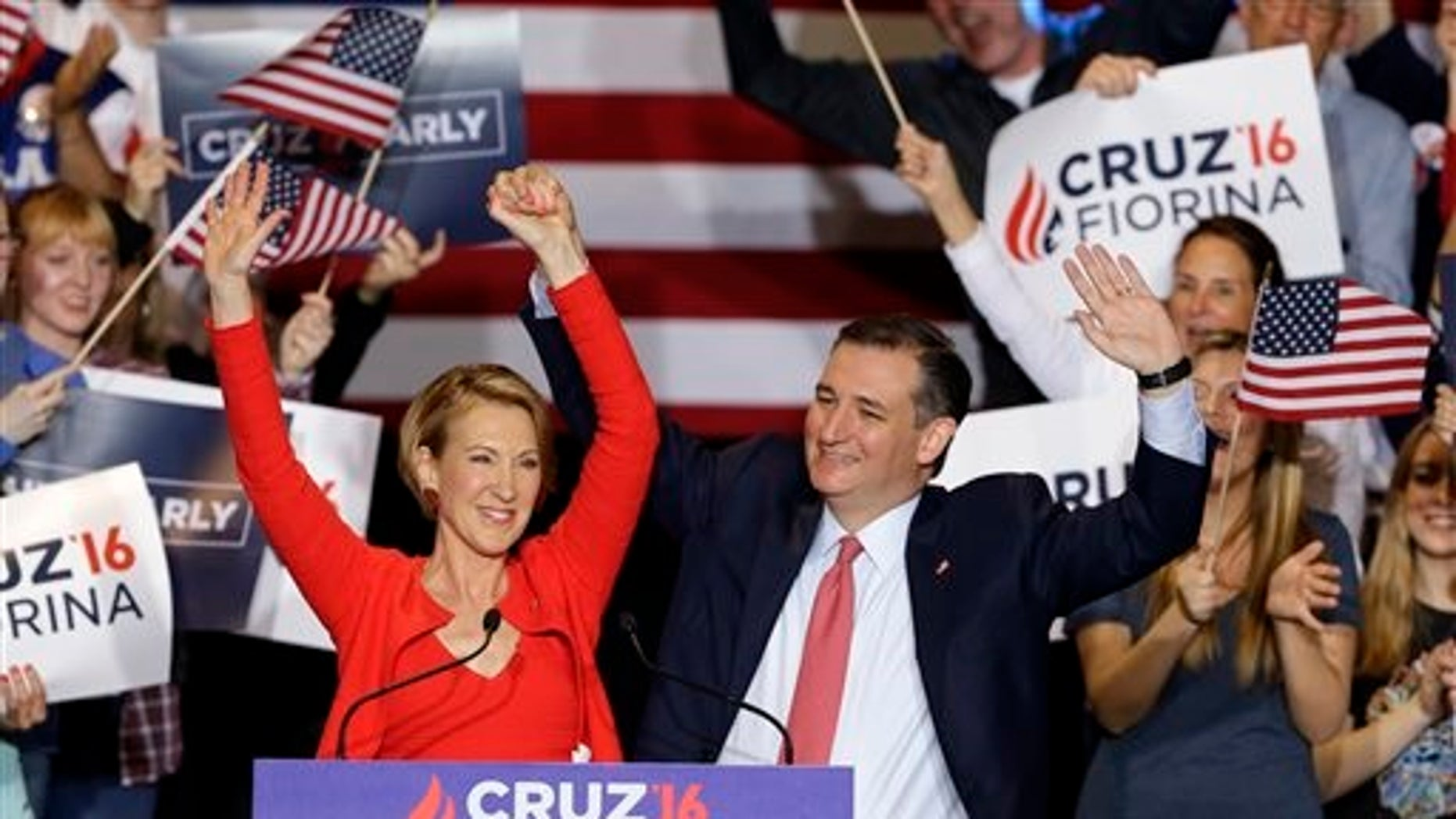 Republican presidential candidate Sen. Ted Cruz, R-Texas, joined by former Hewlett-Packard CEO Carly Fiorina, waves during a rally in Indianapolis, Wednesday, April 27, 2016, when Cruz announced he has chosen Fiorina to serve as his running mate. (AP Photo/Michael Conroy)