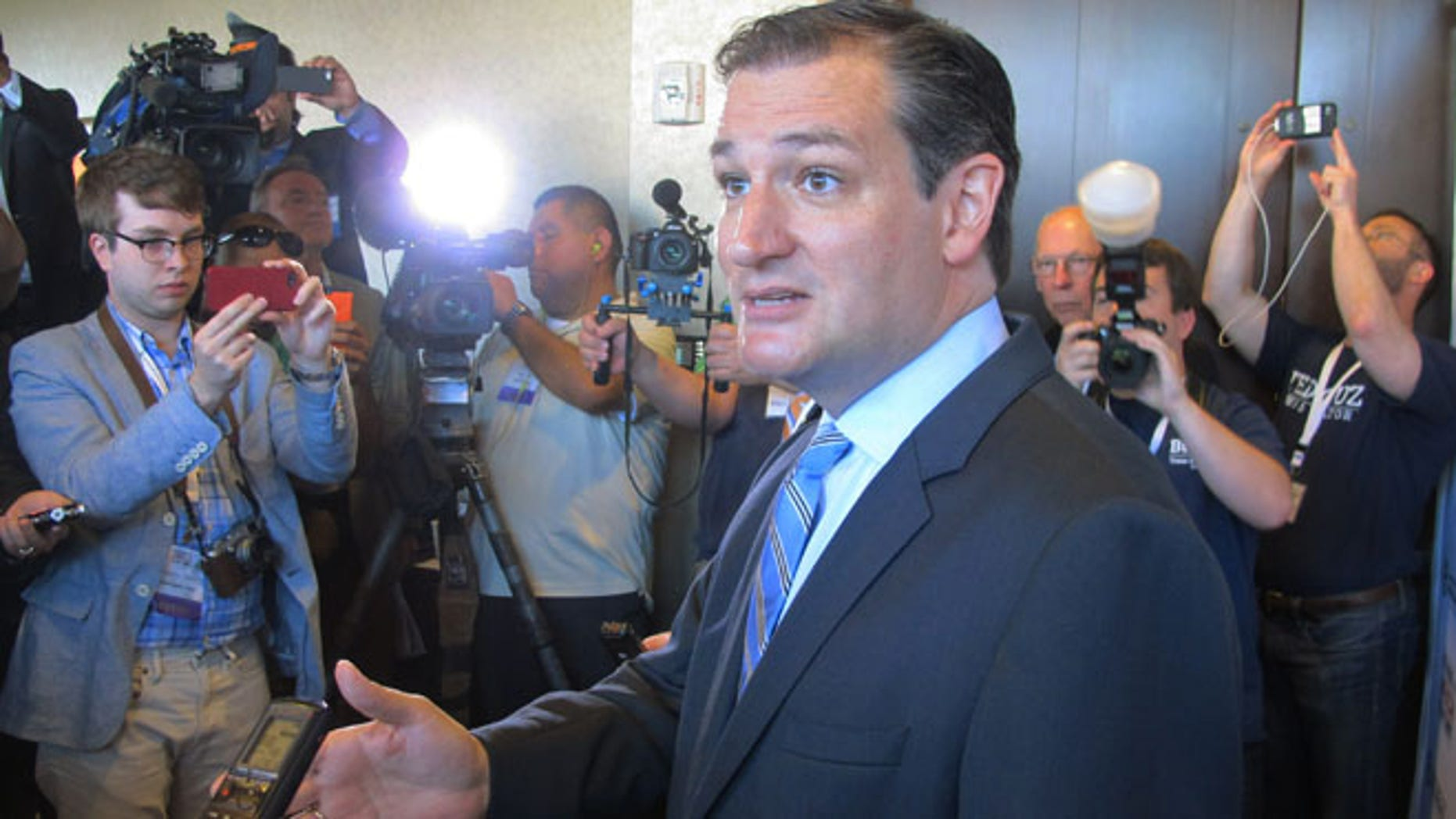 Aug 30, 2014: U.S. Sen. Ted Cruz, R-Texas, speaks to reporters after his speech at the Americans for Prosperity Summit in Dallas. (AP)