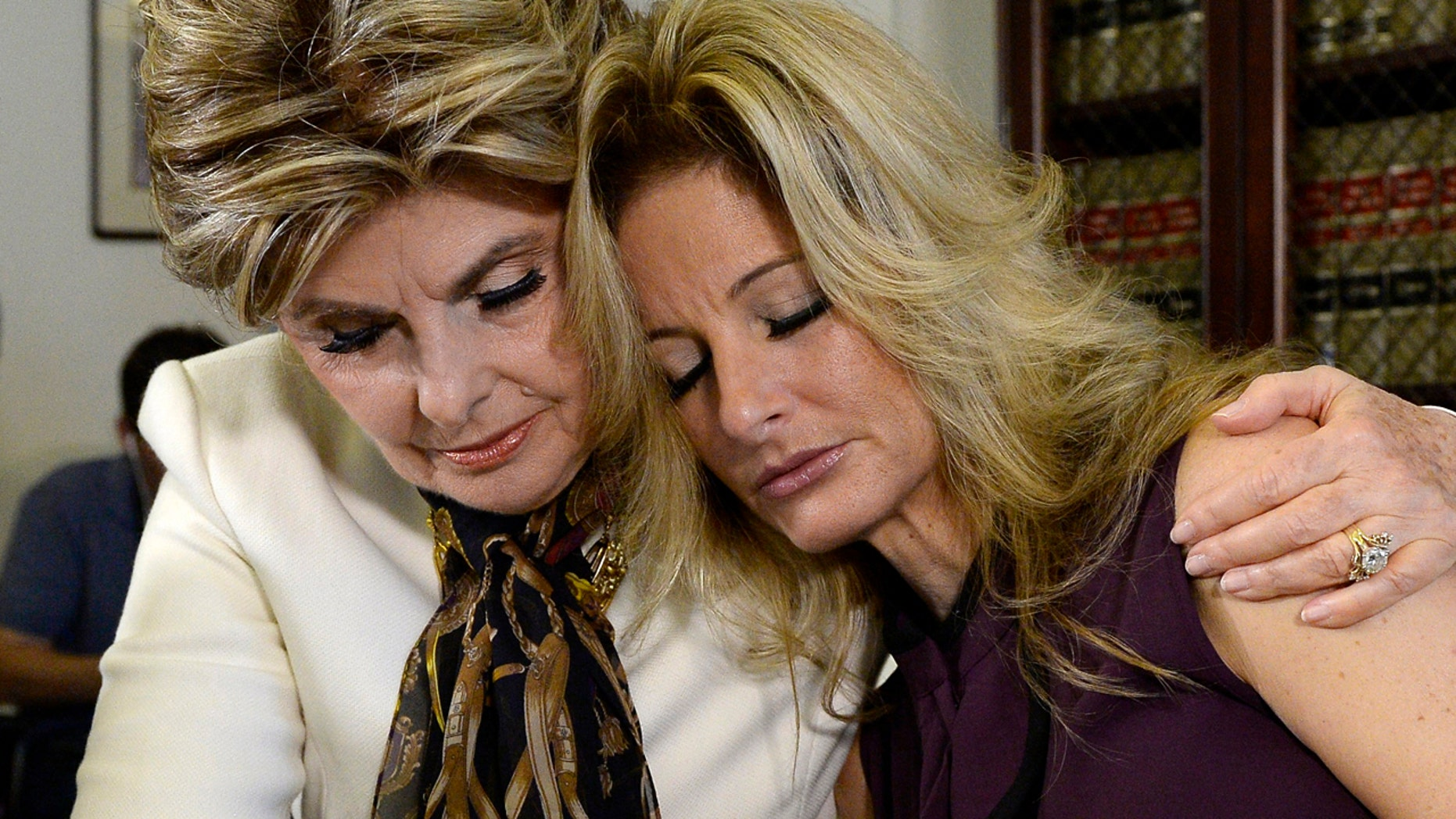 FILE: Summer Zervos, a former contestant on the TV show The Apprentice, is embraced by lawyer Gloria Allred