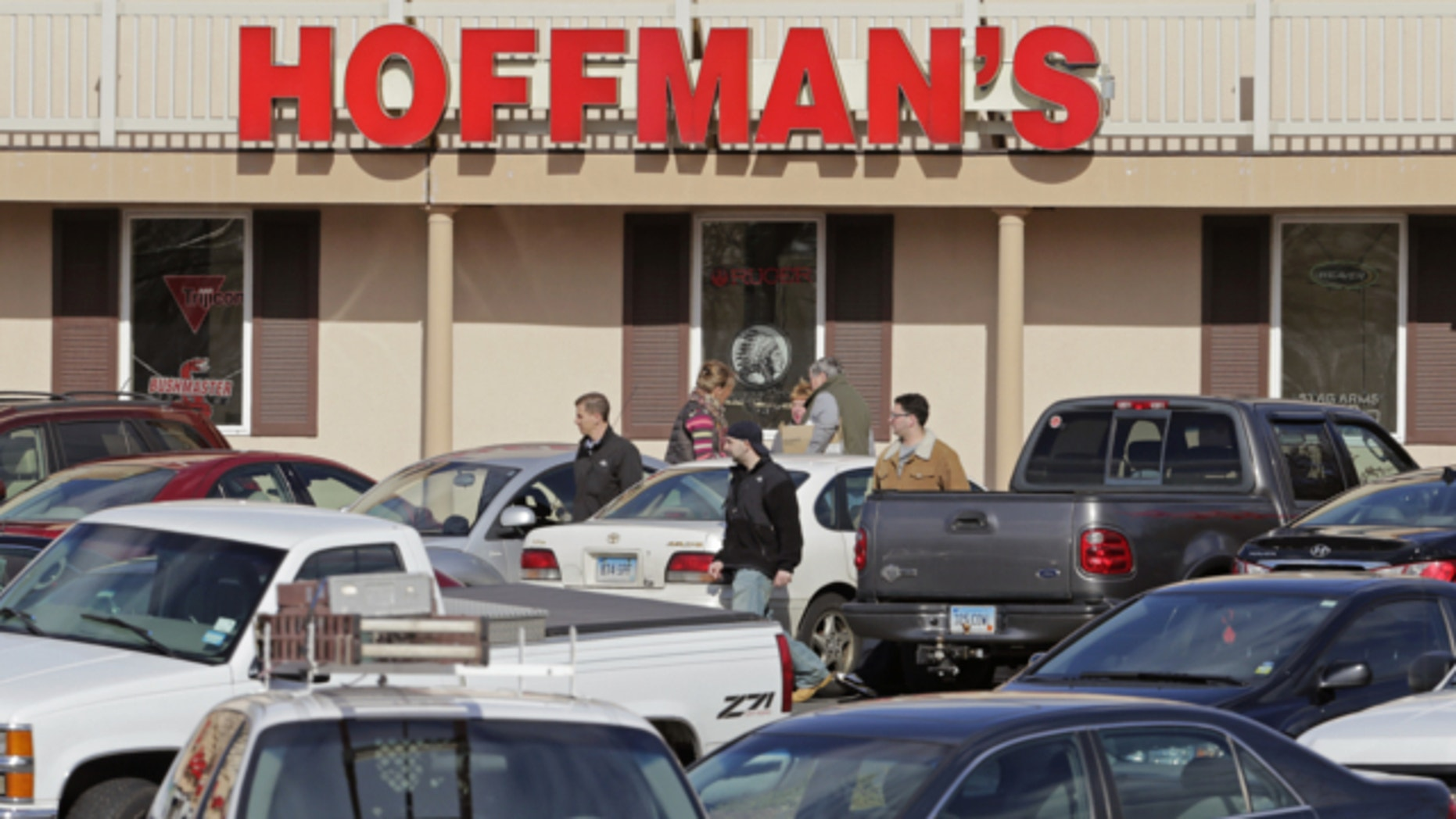 April 2, 2013: Cars jam the parking lot as shoppers leave Hoffman's Gun Center with their purchases in Newington, Conn.