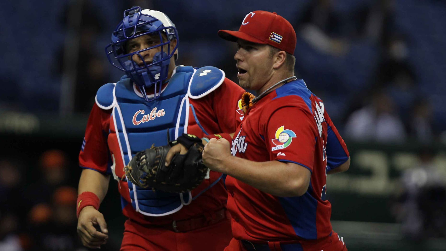 Pitcher Norberto Gonzalez and catcher Eriel Sanchez  of Cuba on March 11, 2013 in Tokyo, Japan.