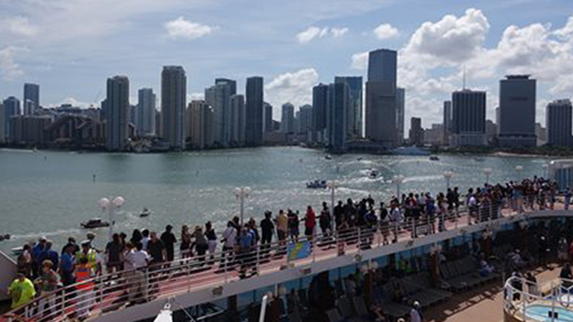 Passengers on board the Adonia watch as the ship leaves port in Miami, Sunday, May 1, 2016, en route to Cuba. After a half-century of waiting, passengers finally set sail on Sunday from Miami on an historic cruise to Cuba.  (Joe Cavaretta/South Florida Sun-Sentinel via AP)