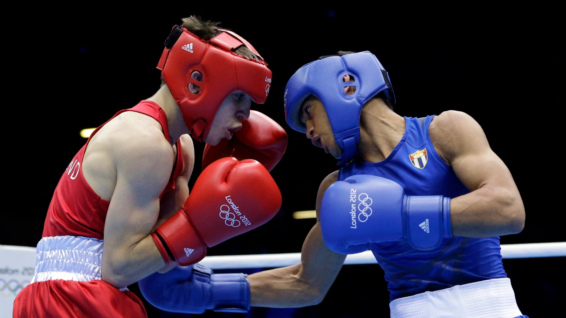Aug. 10, 2012: Ireland's Michael Conlan, left, fights Cuba's Robeisy Ramirez Carrazana in a flyweight 52-kg semifinal boxing match at the 2012 Summer Olympics, Friday, in London.