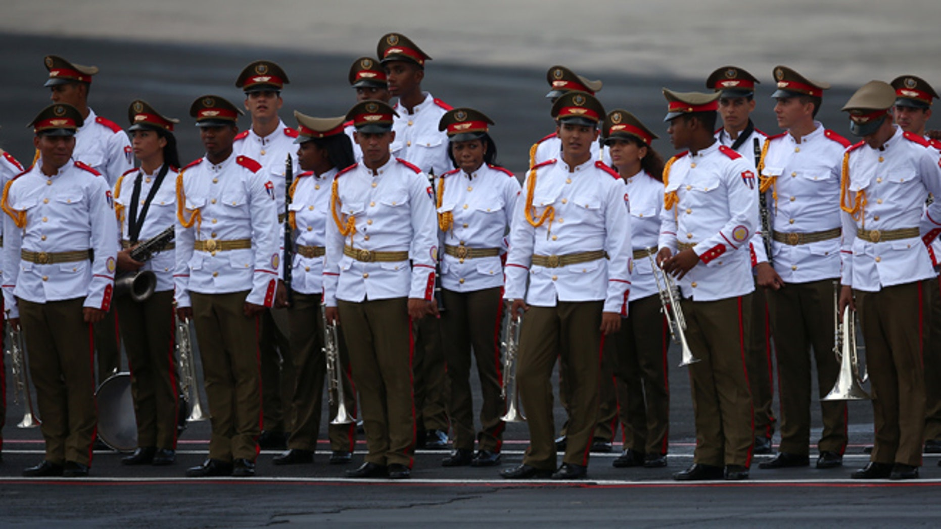 HAVANA, CUBA - SEPTEMBER 19: Cuban military personnel await the arrival of Pope Francis at Jose Marti International Airport on September 19, 2015 in Havana, Cuba. Pope Francis is at the beginning of a three day visit to Cuba where he will meet President Raul Castro and hold Mass in Revolution Square before travelling to Holguin, Santiago de Cuba and El Cobre then onwards to the United States.  (Photo by Carl Court/Getty Images)