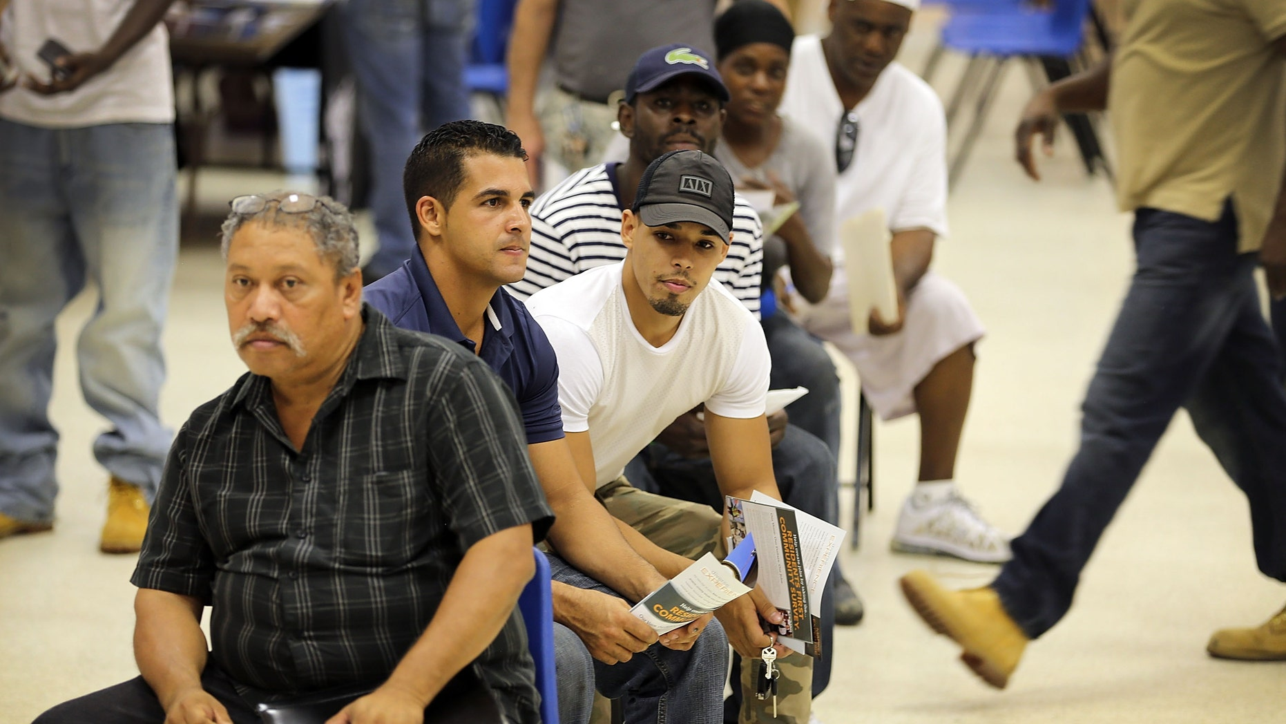 MIAMI, FL - JULY 07:  Job seekers are seated as they wait for an opportunity to apply for a job during the Miami Worldcenter construction job fair on July 7, 2015 in Miami, Florida. Miami Worldcenter is a real estate development projected that is expected to be built on 27 acres of vacant land in the center of Downtown Miami's urban core and  during phase one of the project, estimates to yield approximately 18,000 direct jobs and $1 billion in new economic impact, according to a study released by Miami Worldcenter.  (Photo by Joe Raedle/Getty Images)