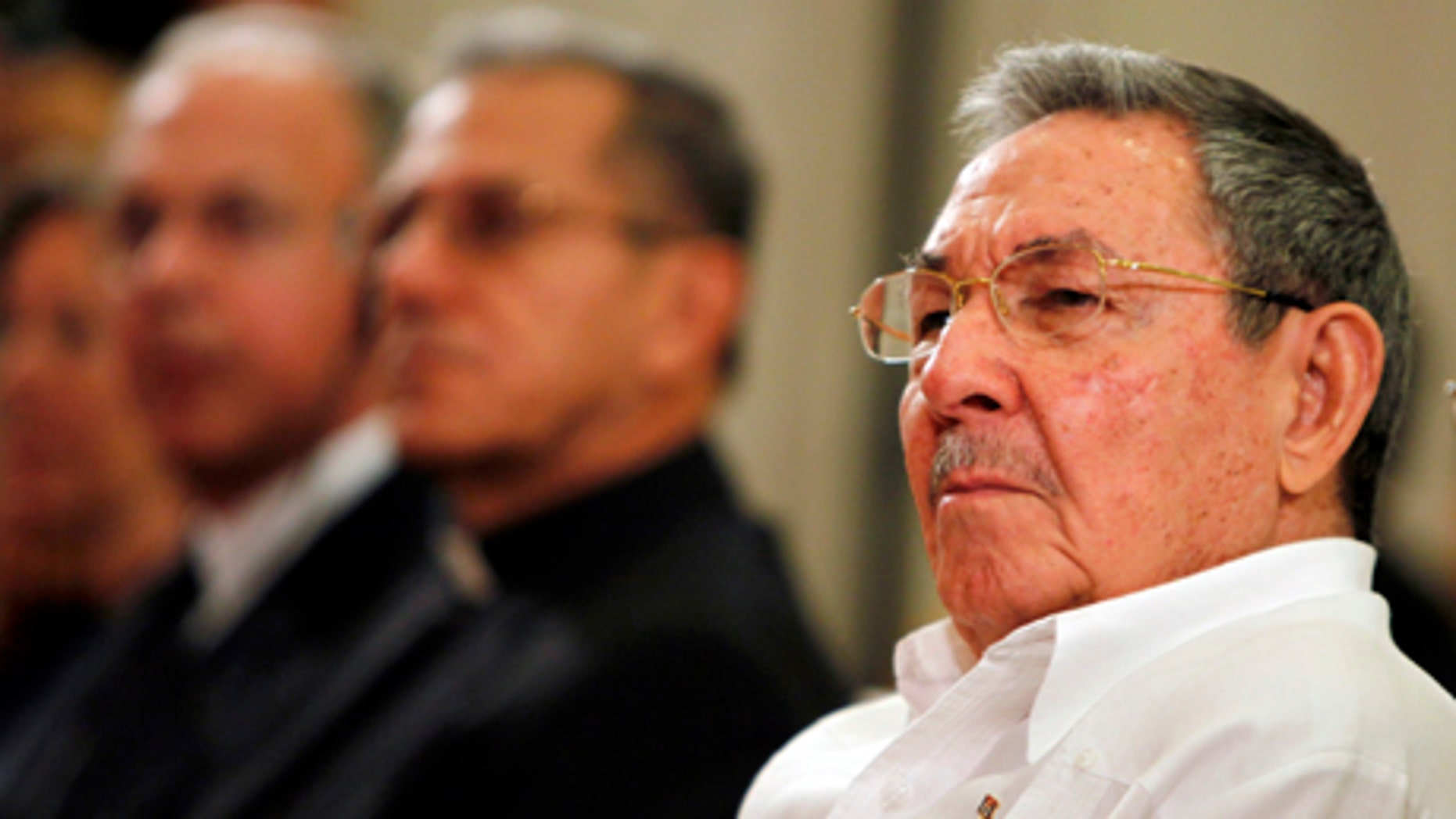 Cuba's President Raul Castro attends the opening ceremony of a new Catholic Seminary in Havana, Cuba, Wednesday Nov. 3, 2010. Castro joined Archbishop Thomas G. Wenski of Miami and other Roman Catholic leaders to open the national seminary, the first religious construction on the communist-run island in more than a half century. (AP Photo/Javier Galeano)