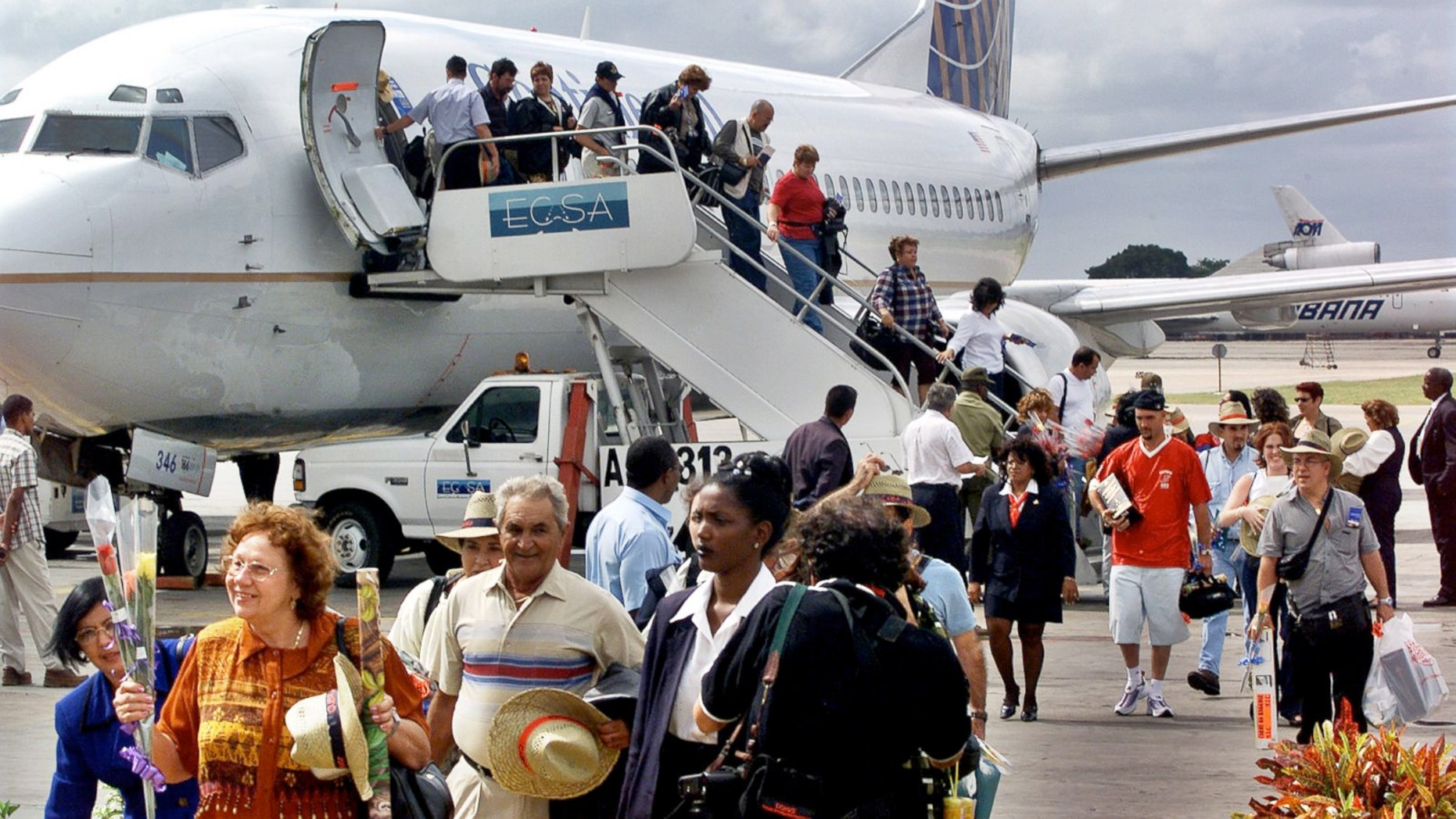 FILE:The first passengers of the first chartered flight of Continental Airlines from Miami Florida, arrives at the Jose Marti Airport of Havana, Cuba.