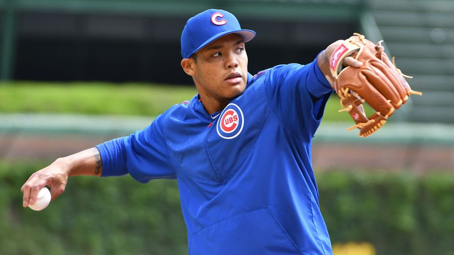 CHICAGO, IL - MAY 21: Chicago Cubs Shortstop Addison Russell (27) warms up before a MLB game between the Chicago Cubs and Milwaukee Brewers on May 21, 2017 at Wrigley Field in Chicago, IL. The Cubs defeated the Brewers 13-6. (Photo by Nick Wosika/Icon Sportswire via Getty Images)
