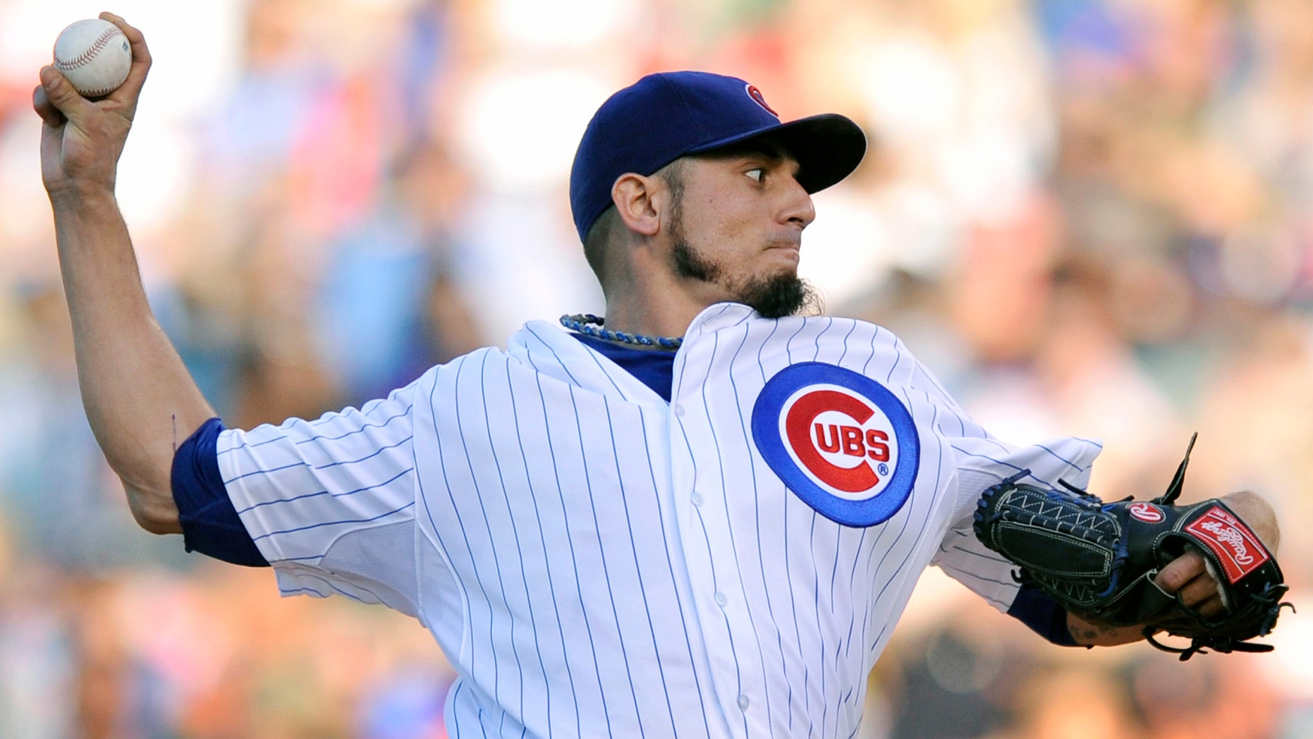 Chicago Cubs starter Matt Garza delivers a pitch during the first inning against the St. Louis Cardinals in Chicago, Saturday, July 13.