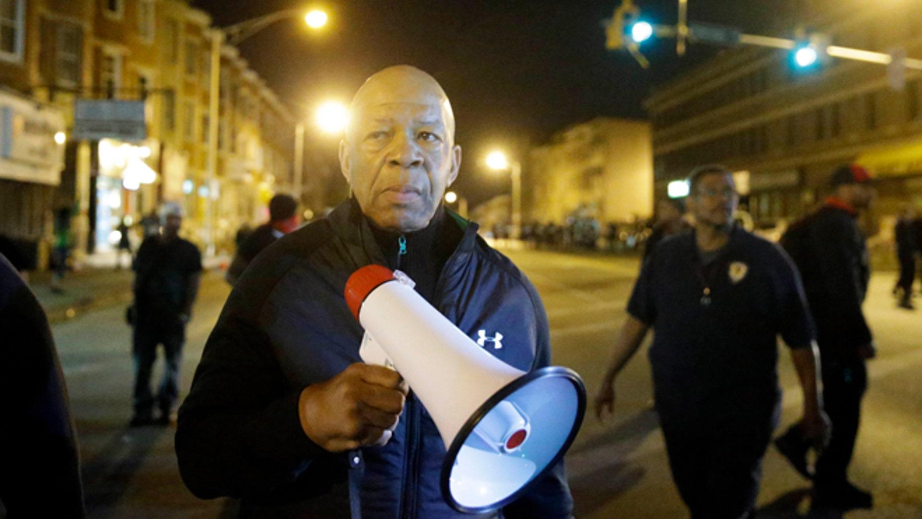 April 29, 2015: U.S. Rep. Elijah Cummings, D-Md., walks in Baltimore, amid protests over Freddie Gray's death.