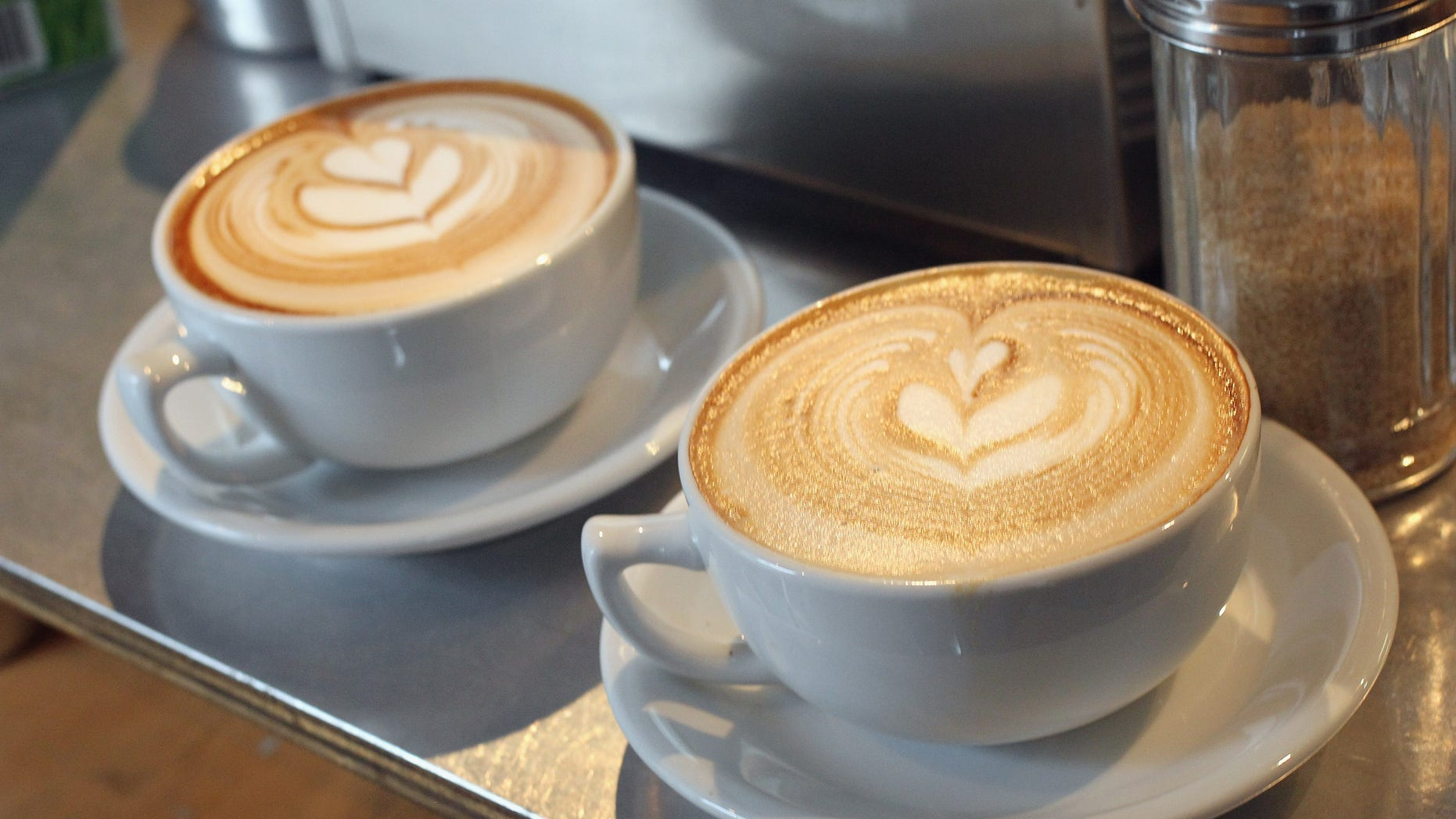 BERLIN, GERMANY - JANUARY 24:  Cups of just-brewed flat white, a variation on the classic cappuccino, stand on a counter at Bonanza Coffee Roasters on January 24, 2011 in Berlin, Germany. Bonanza founder Kiduk Reus is among a growing number of so-called third wave artisinal coffee bean roasters who are finding a niche market in Europe and the USA for their carefully-crafted and expensive coffee. Reus insists that the cast iron parts, the slow-roasting abilities and hands-on controls of his flame-roasting, refurbished 1918 Probat machine allow him to develop the most flavour from his carefully selected beans.  (Photo by Sean Gallup/Getty Images)