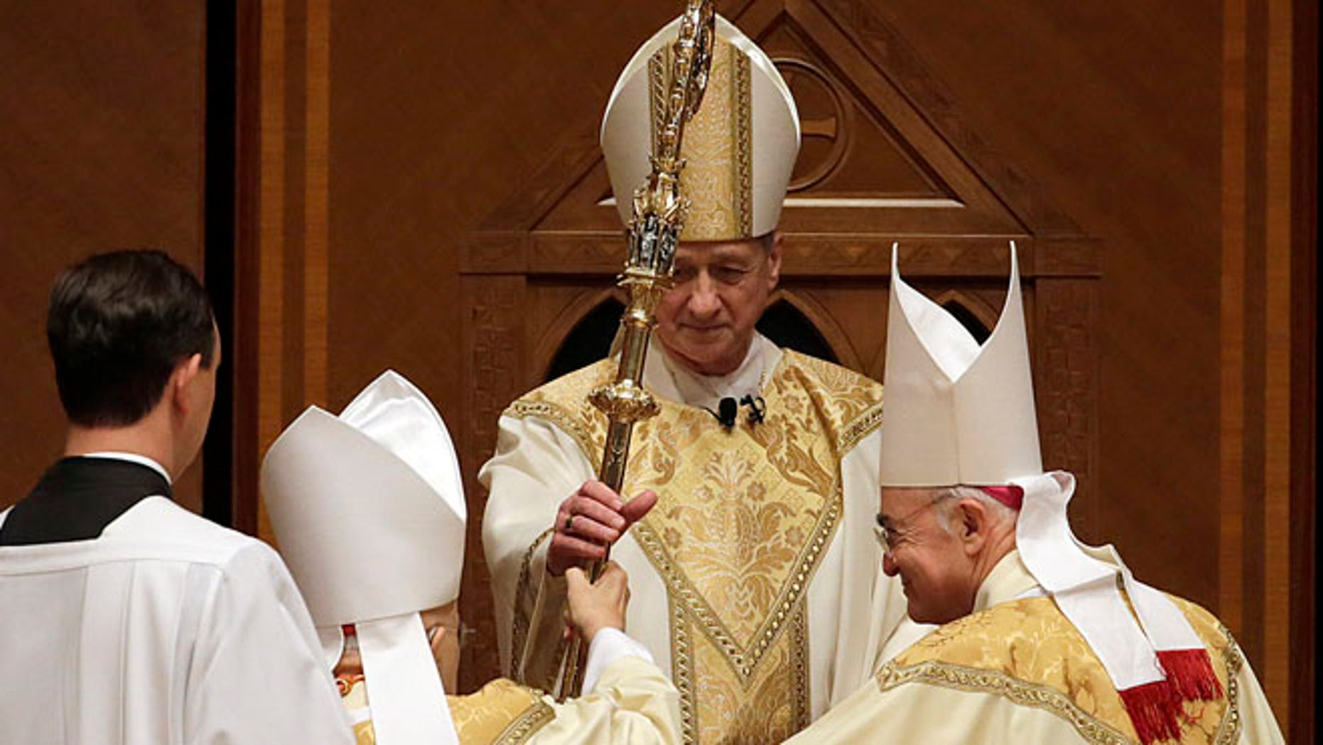 Nov. 18, 2014: The retiring Cardinal Francis George presents the crozier to the Archbishop Blase Cupich during his Installation Mass at Holy Name Cathedral in Chicago. (AP)
