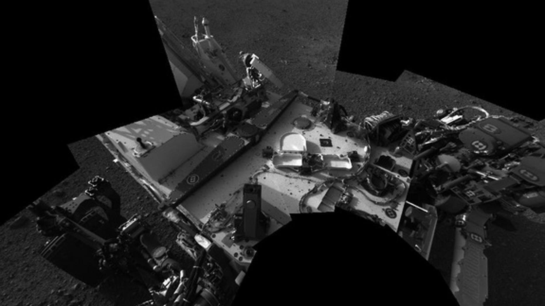 This view of Mars, taken by NASA's Curiosity rover on Sol 3 (Aug. 8-9, 2012), shows an early view of the rover's deck as viewed from mast cameras.