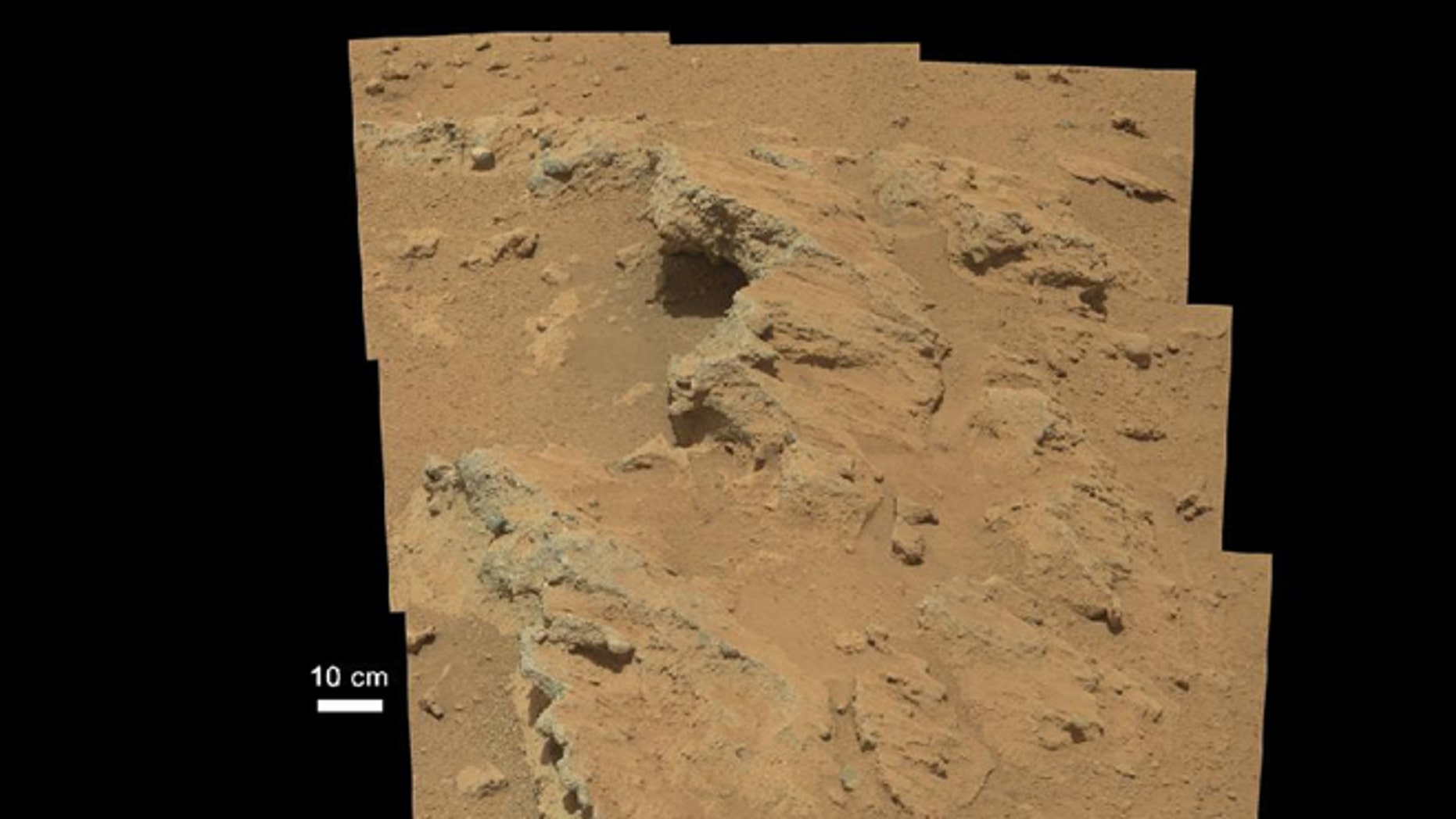 This image provided by NASA shows shows a Martian rock outcrop near the landing site of the rover Curiosity thought to be the site of an ancient streambed.