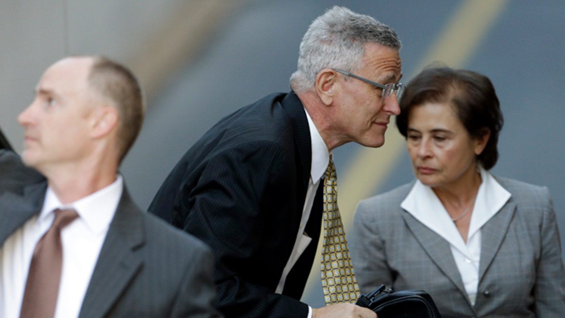 July 29, 2013: Former Penn State director of athletics Tim Curley enters the Dauphin County Courthouse in Harrisburg, Pa. Curley, Graham Spanier and Gary Schultz are to go before a judge Monday to determine whether the three must face trial on charges they covered up an allegation that Jerry Sandusky was sexually preying on boys. (AP/Matt Rourke)