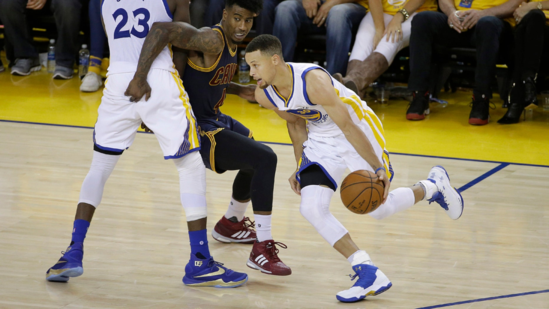 June 5, 2016: Golden State Warriors guard Stephen Curry (30) dribbles as forward Draymond Green (23) blocks Cleveland Cavaliers guard Iman Shumpert during the second half of Game 2 of basketball's NBA Finals in Oakland, Calif.