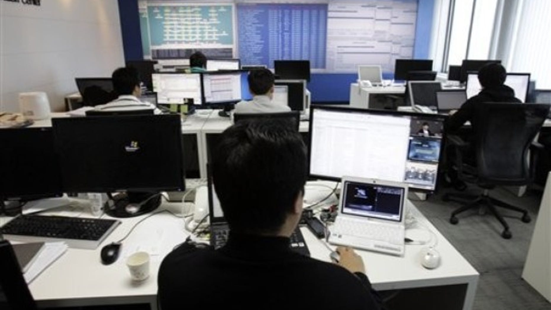 Technicians of AhnLab Inc. work against cyberattacks at the company's Security Operation Center in Seoul, South Korea