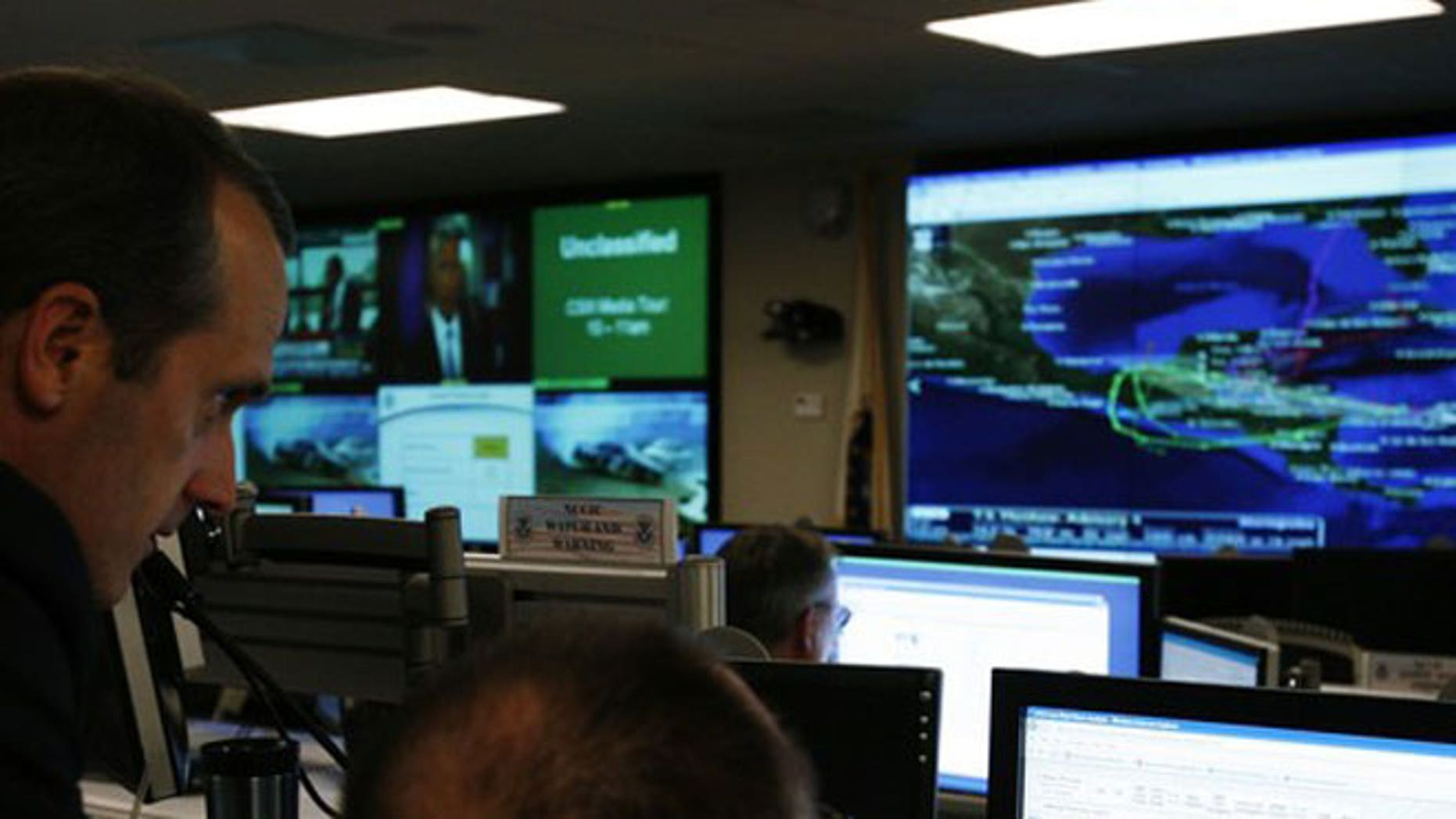 In this September 24, 2010 file photo, U.S. Department of Homeland Security analysts work at the National Cybersecurity & Communications Integration Center (NCCIC) located just outside Washington in Arlington, Virginia.