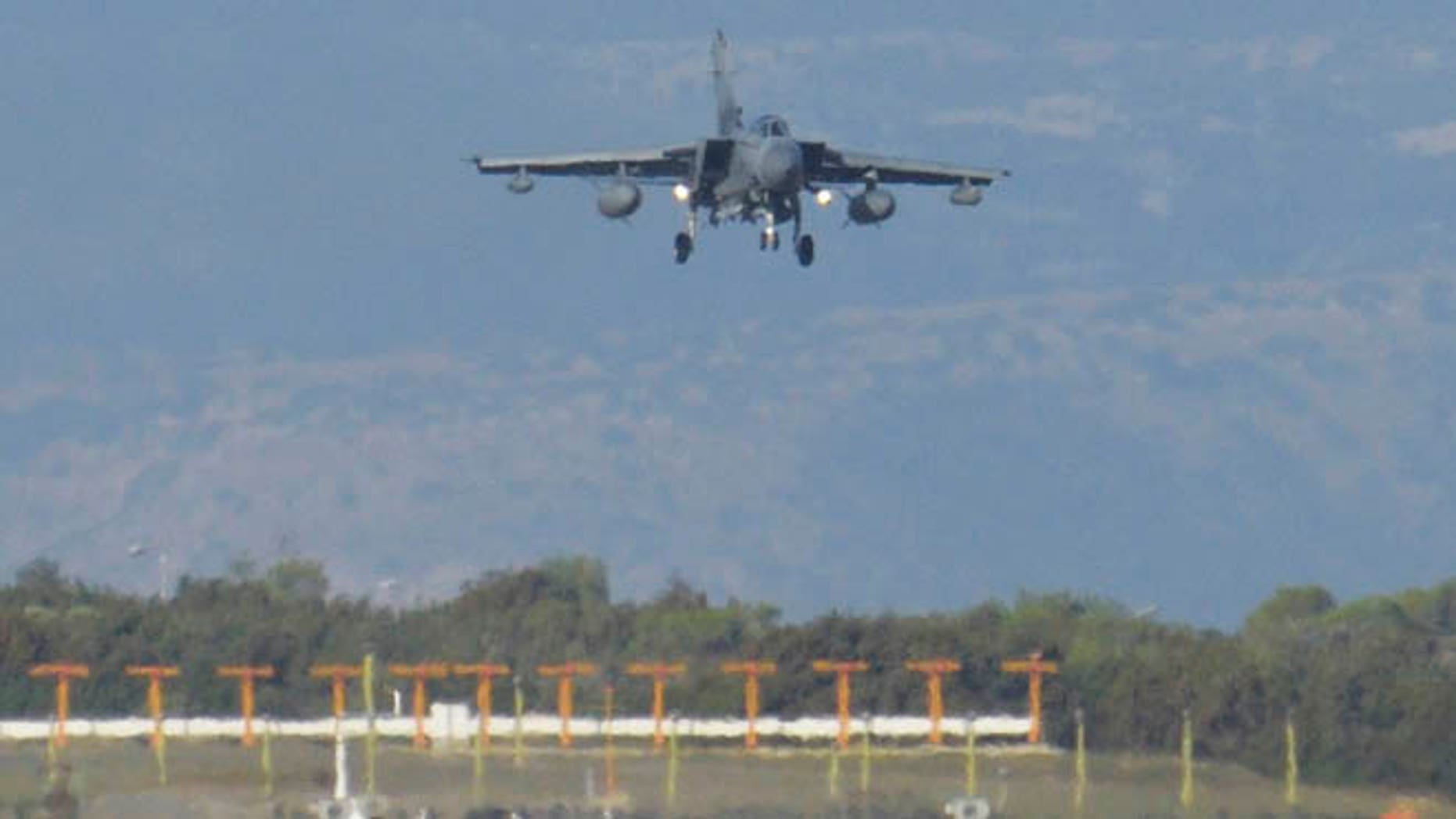 Dec. 3, 2015: A British Tornado warplane lands at the RAF Akrotiri, a British air base near coastal city of Limassol, Cyprus, after arriving from an airstrike against Islamic State group targets in Syria.