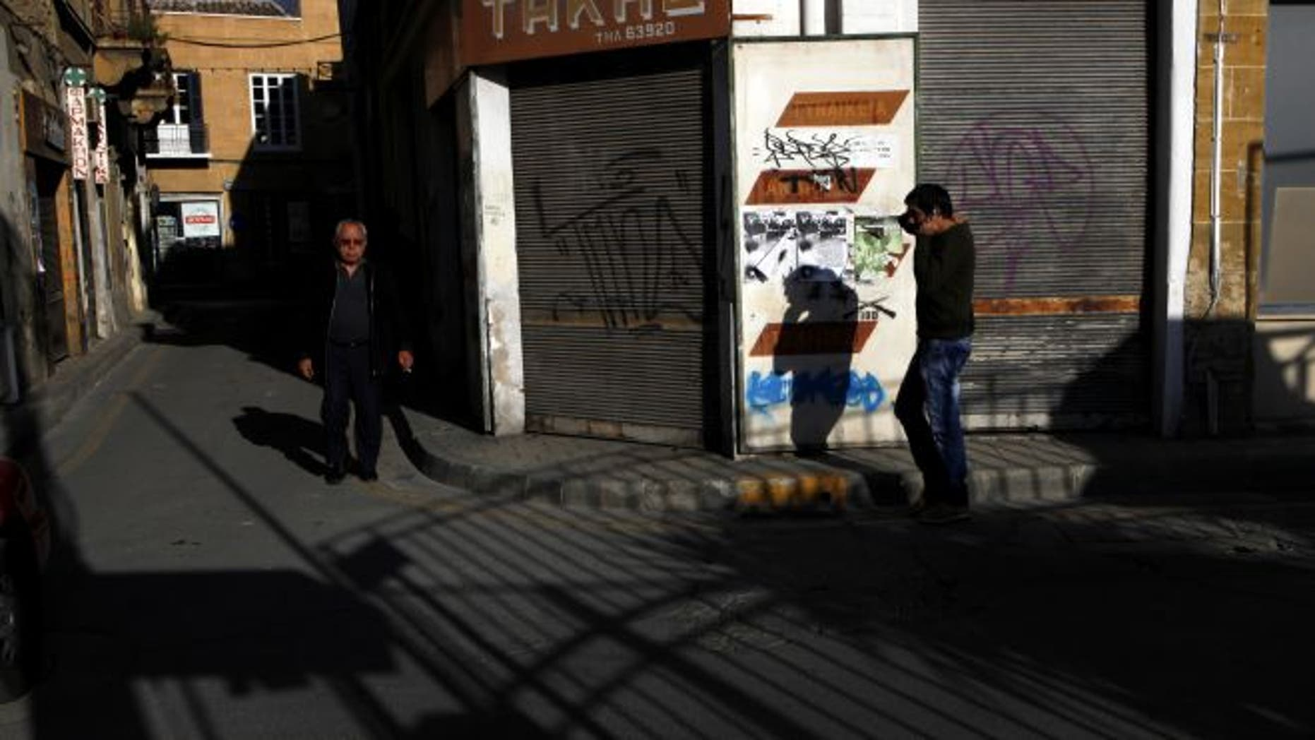 March 23, 2013: People walk at the old city of capital Nicosia, Cyprus.