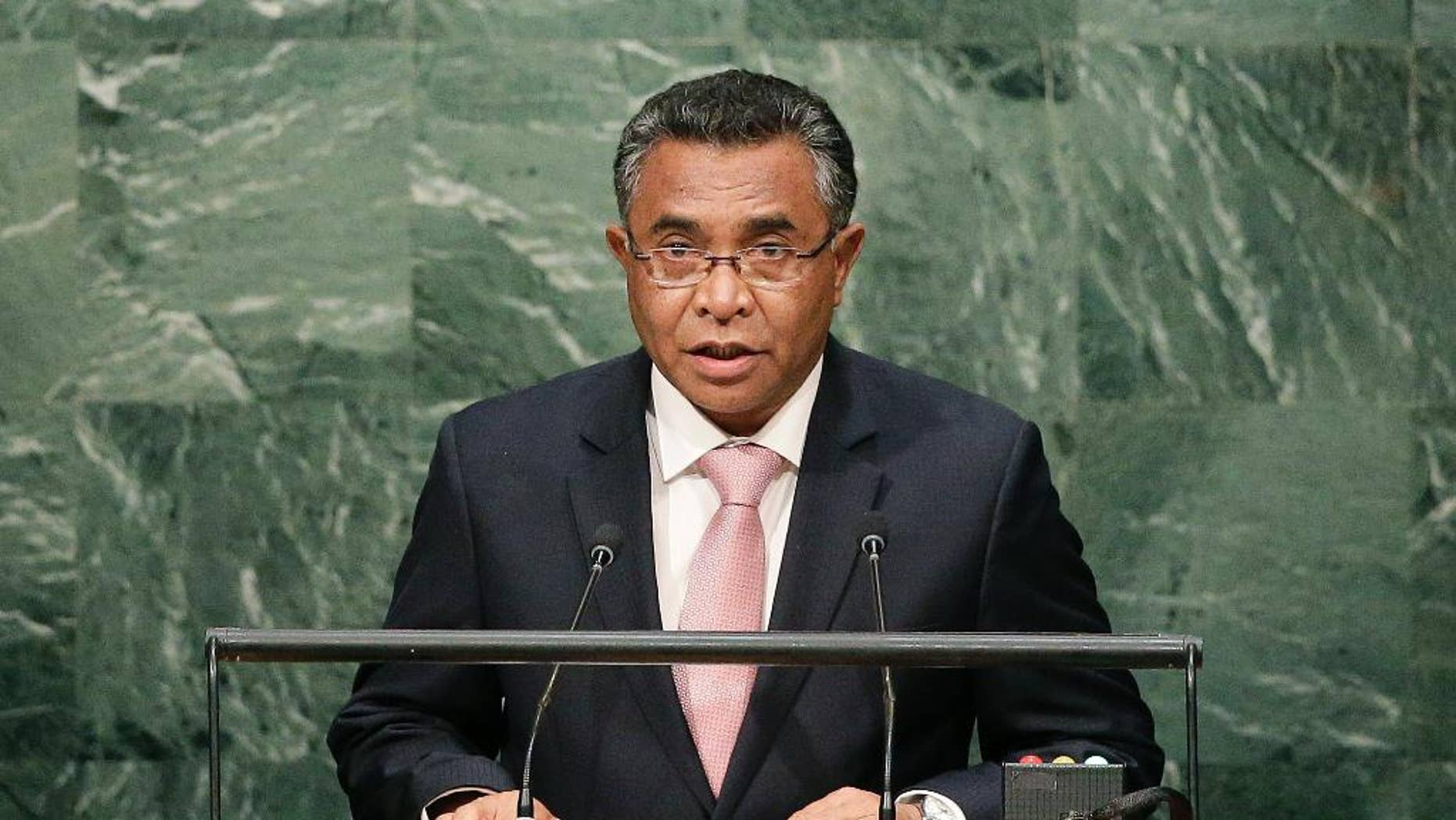 """FILE - In this Oct. 1, 2015 file photo, East Timorese Prime Minister Rui Maria de Araujo speaks during the 70th session of the United Nations General Assembly at the U.N. headquarters. Two East Timorese journalists are going on trial in a criminal defamation case brought by Araujo that has alarmed press freedom groups. Raimundos Oki and his former boss Lourenco Vicente Martins are charged with """"slanderous denunciation"""" and face up to three years in prison if found guilty. The trial is set to begin Friday, Oct. 7, 2016. Oki and Martins published a story in the Timor Post last year about Araujo's involvement in a state contract for information technology services when he was an adviser to East Timor's finance minister in 2014. (AP Photo/Julie Jacobson, File)"""